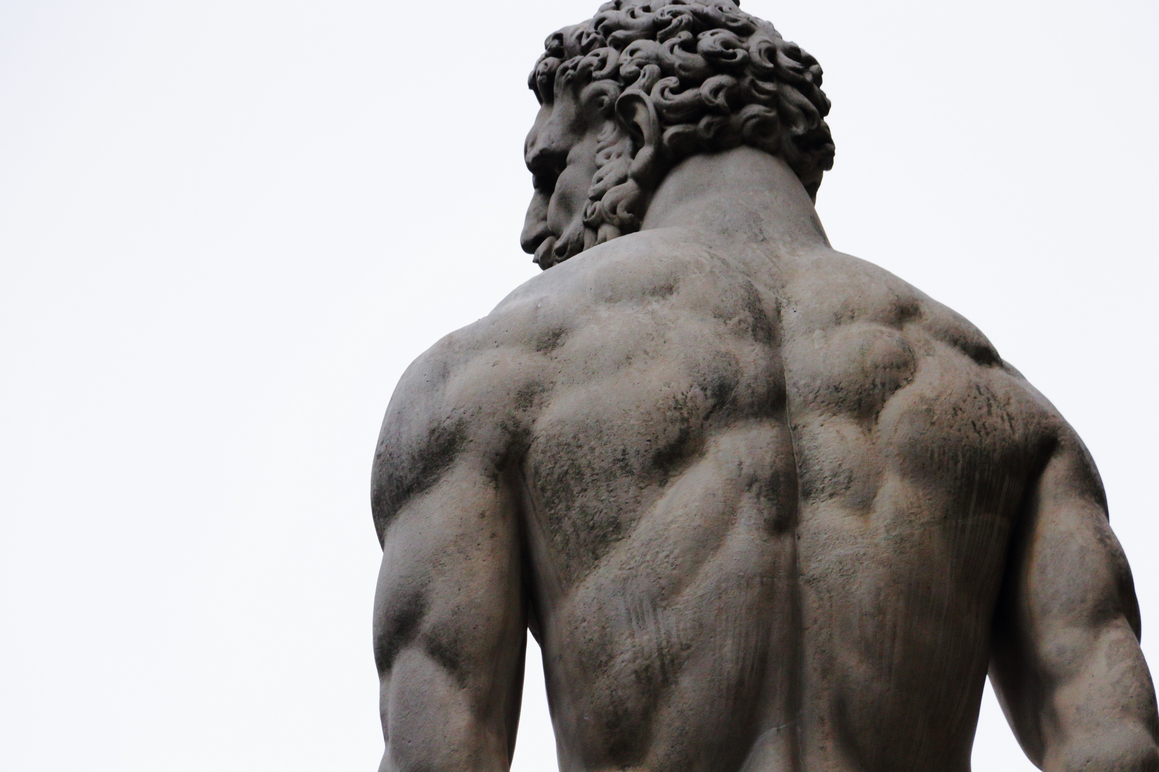 Man with his back against us