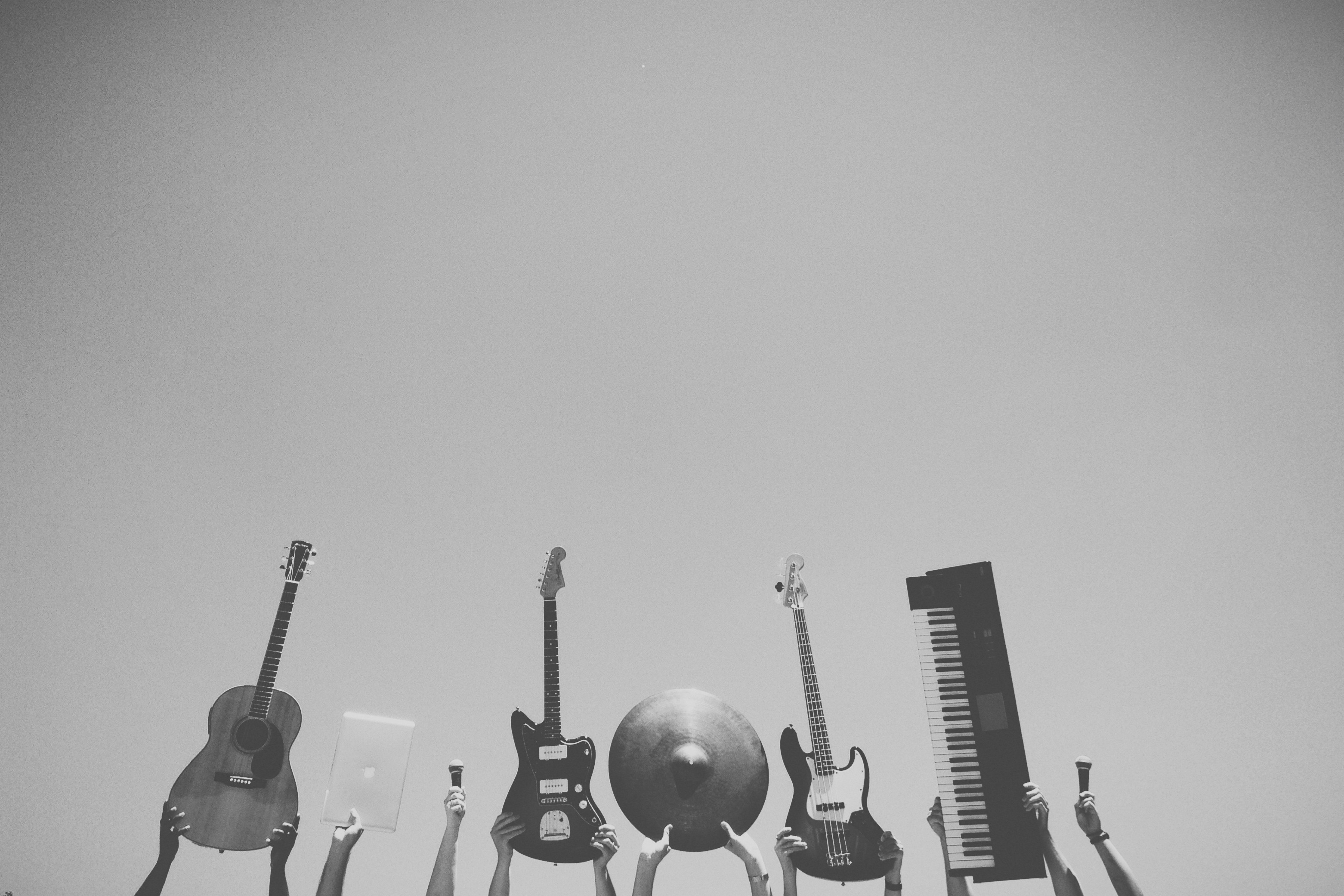 Guitar and music instruments arranged in a row.