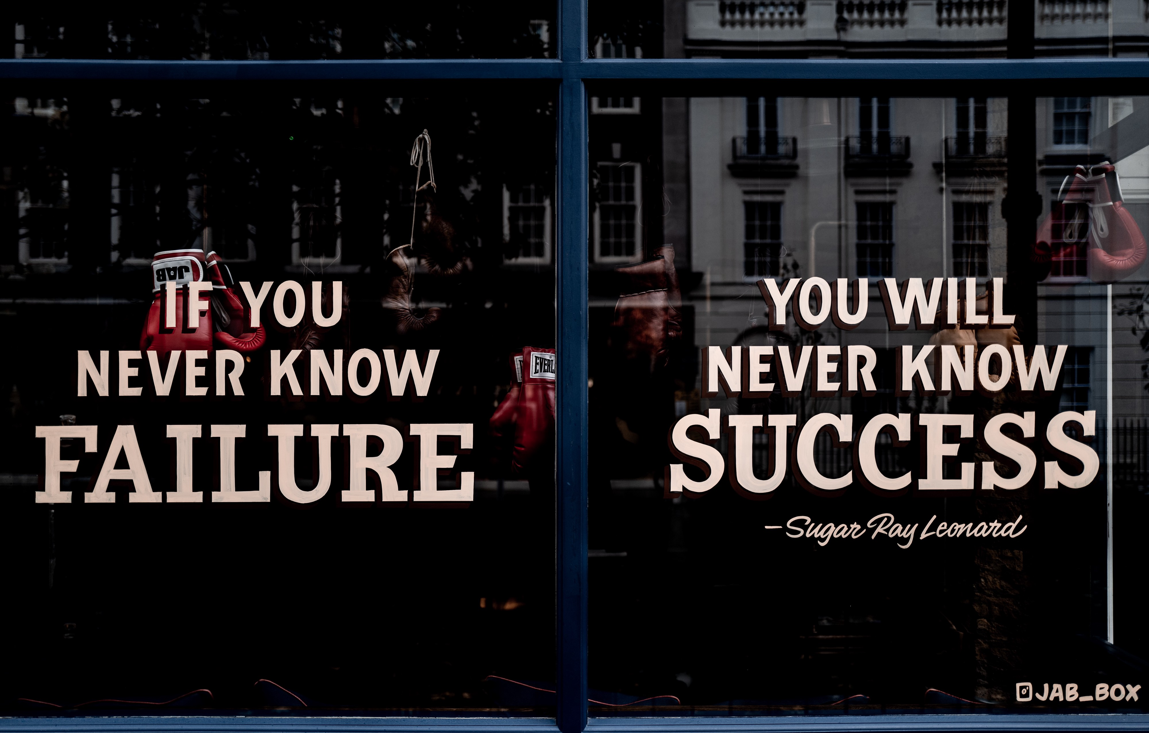 """If you never know failure, you will never know success."" Quote on boxing gym window."