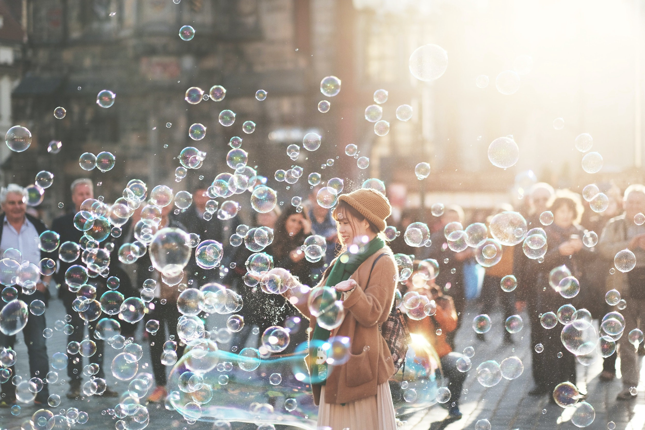 Woman stands in swam of bubbles
