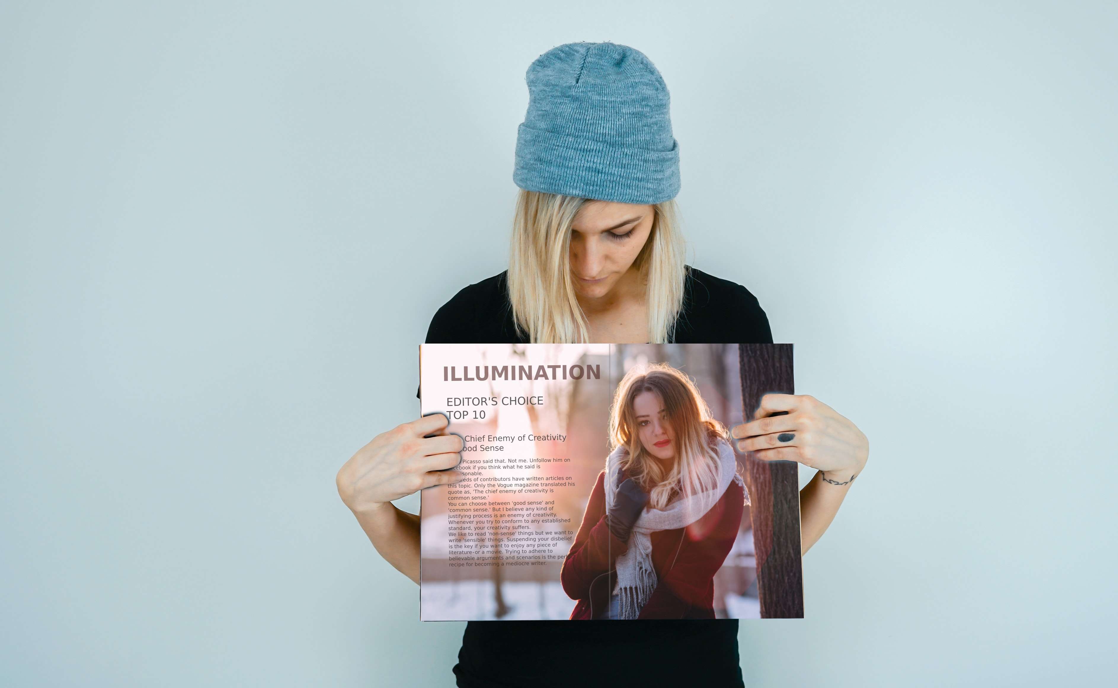 Girl standing with a cap and a magazine in her hands with text: Illumination—Editor's Choice