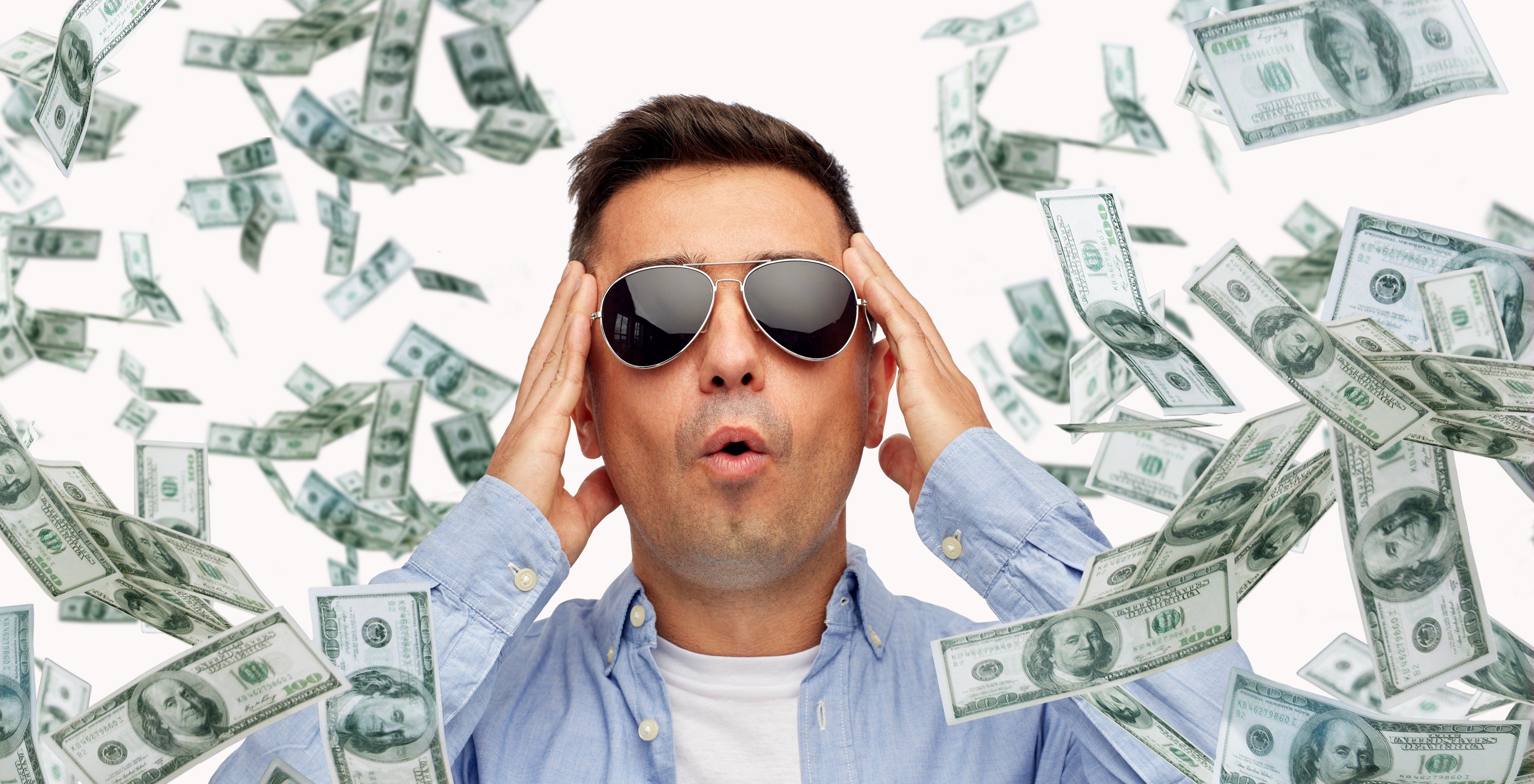 Close up picture of a surprised middle-aged latin man with sunglasses, surrounded by heaps of $100 bills