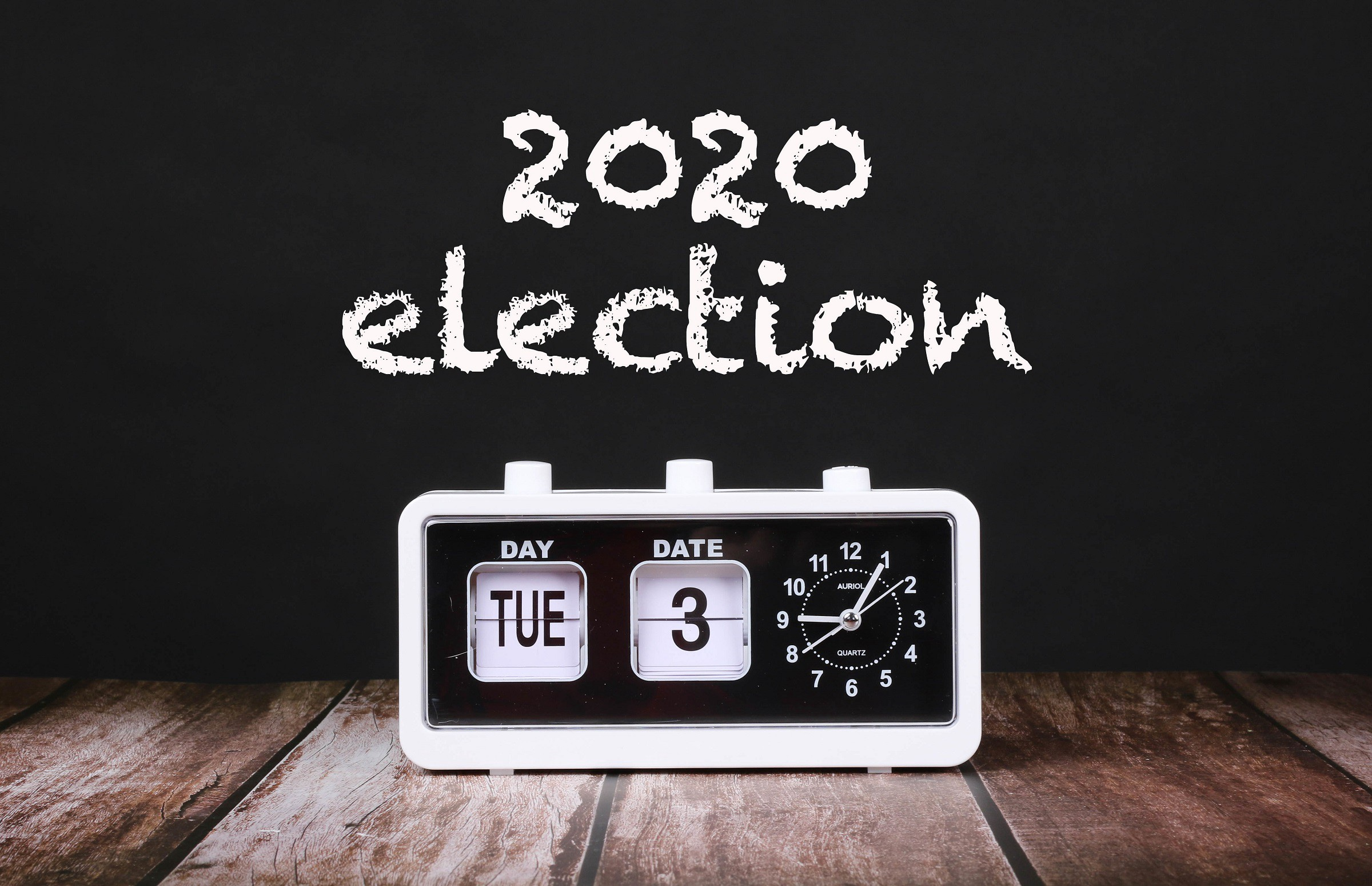 Black and white clock showing Tue 3 under 2020 election header