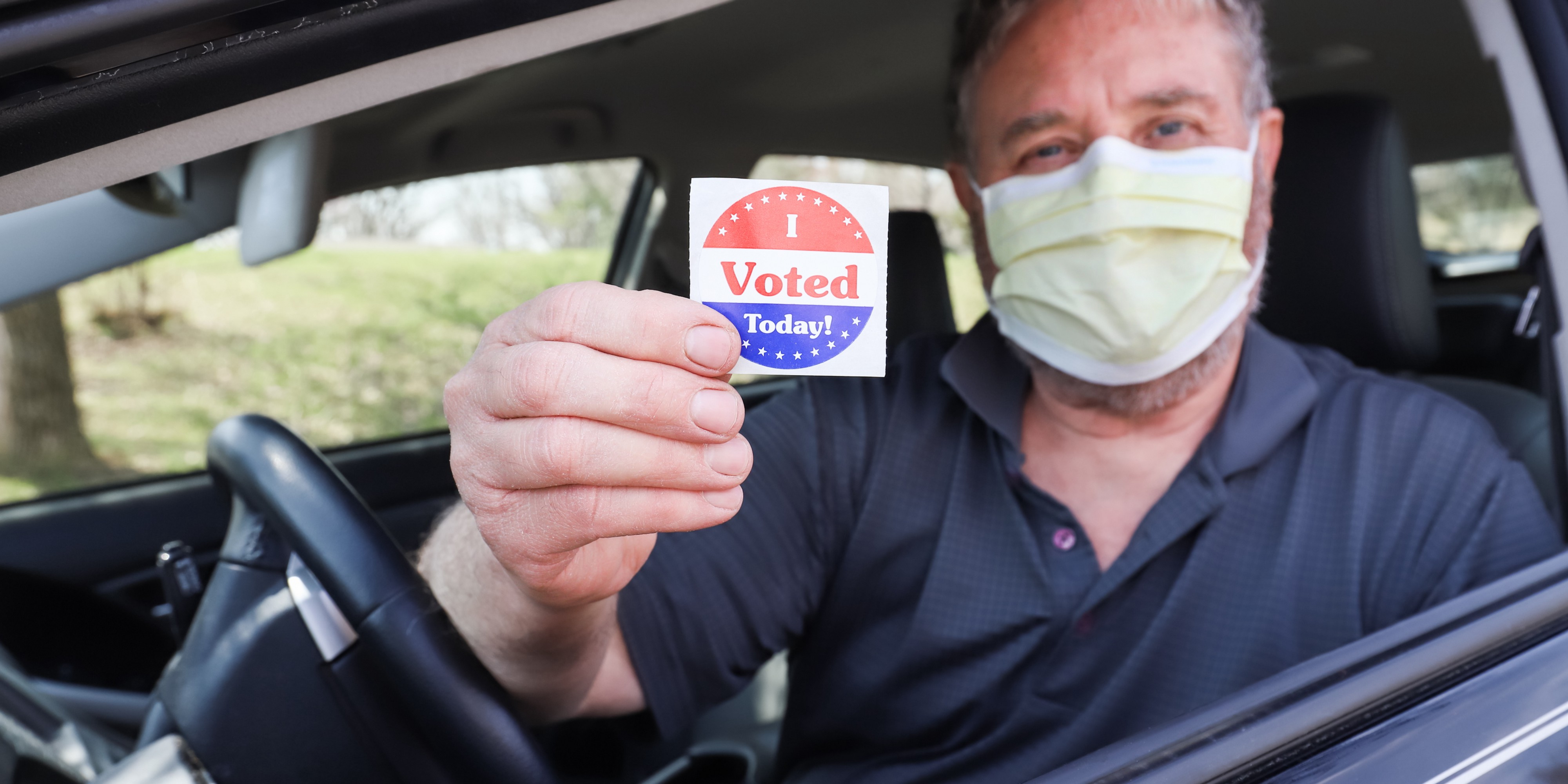 """Man with mask holding """"I Voted Today"""" Sticker"""