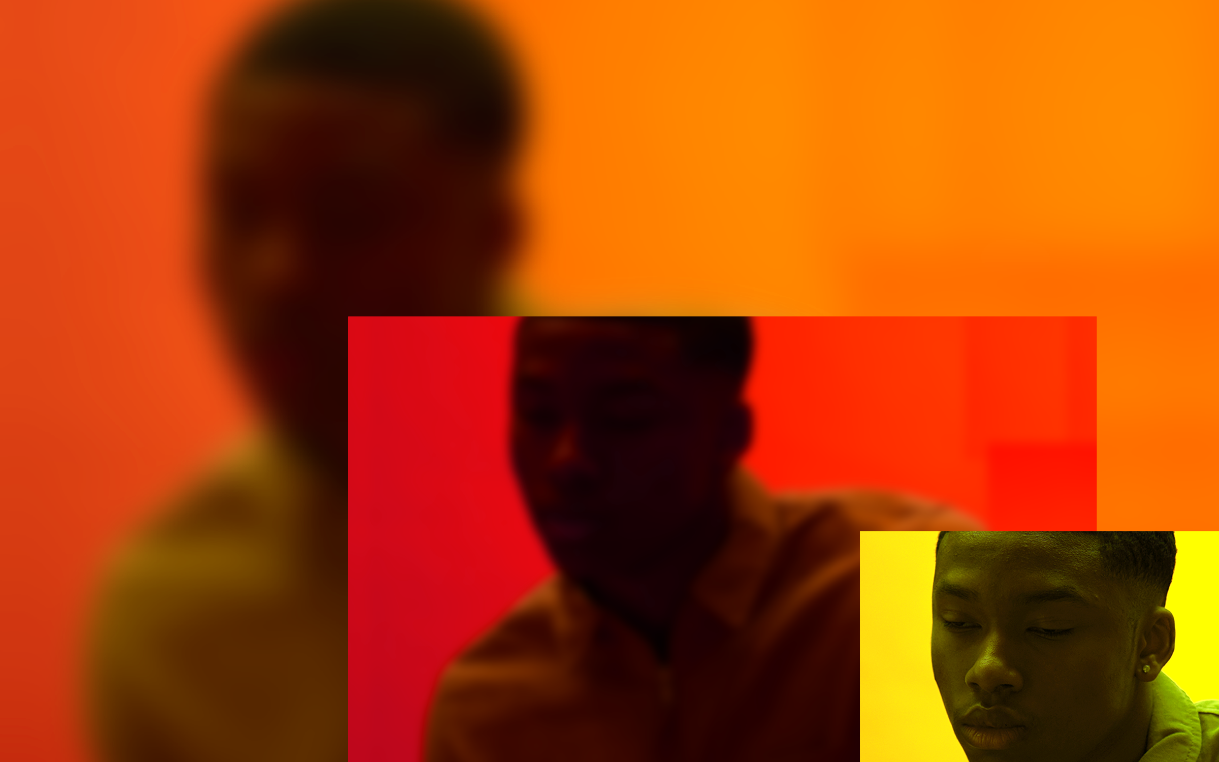 In the lower left corner of this photo is a small rectangle with closeup of a depressed-looking Black person against a yellow background. A larger, zoomed-out, slightly blurry version of the same image, but colored red, is to the left of the small rectangle, which overlaps it slightly. The background is an even more zoomed-out and blurry version of the pic, colored orange.