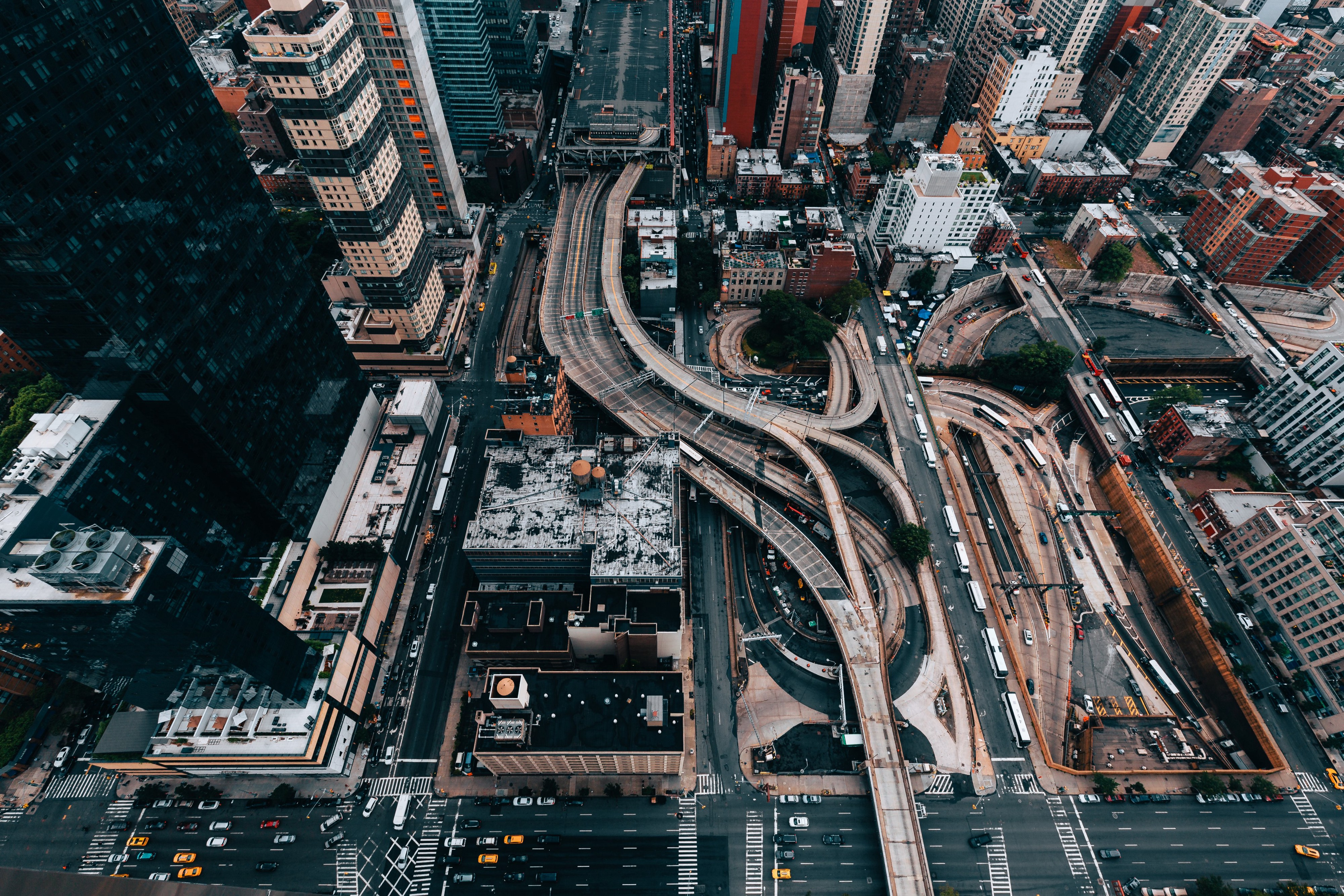 Looking straight down at large city streets and overpasses in an urban center.