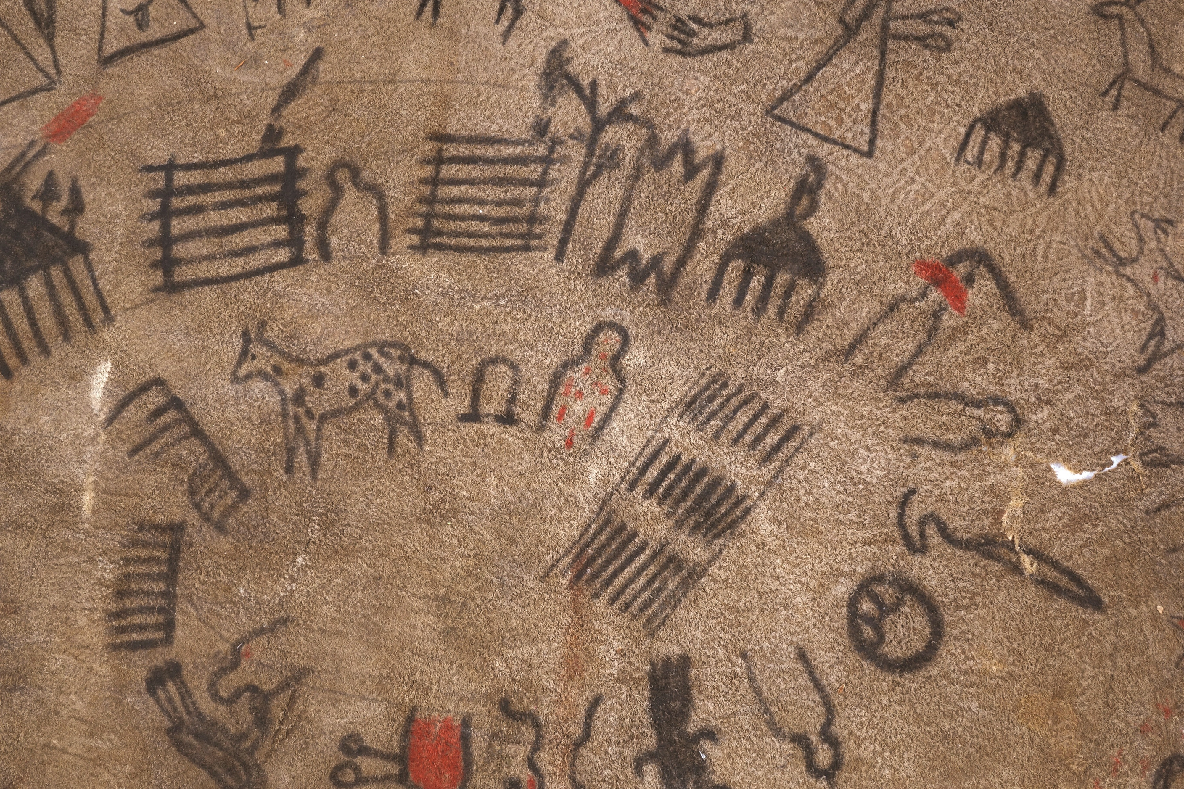 Detail of Lakota Winter Count, a pictorial calendar, including image of person with red dots representing smallpox epidemic