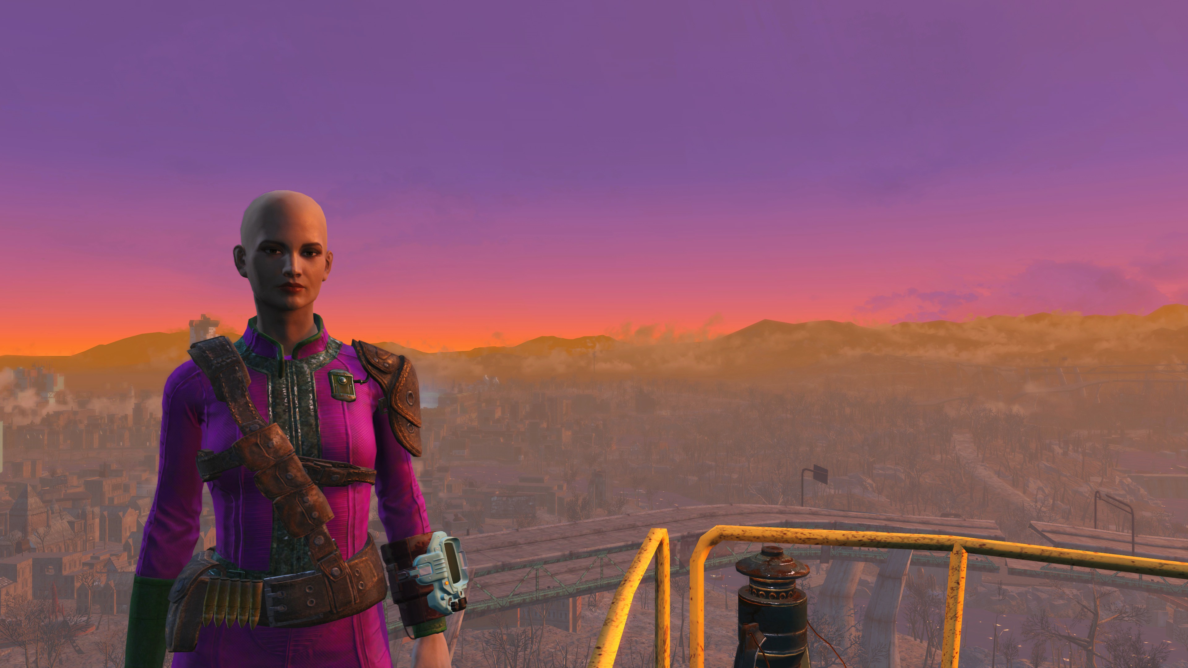 My partner's Fallout 4 character with a purple and orange sunset behind her.