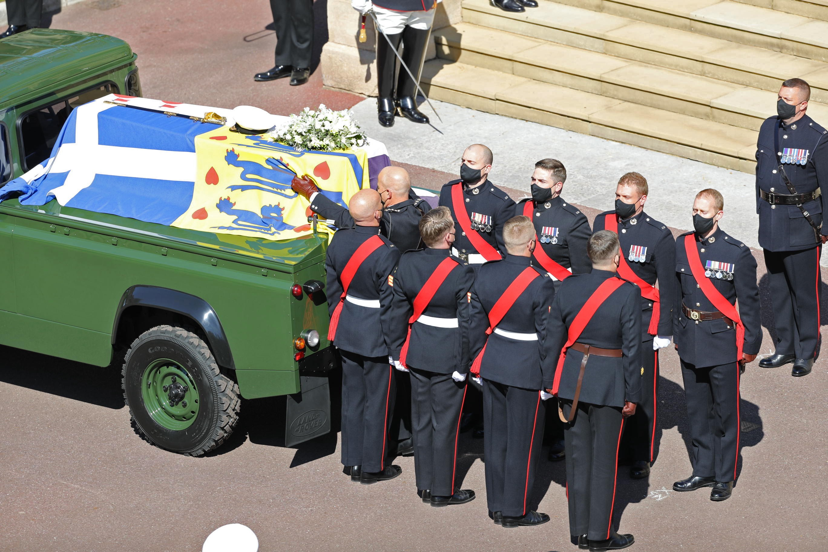Image of a Royal Marines Bearer Party, seen here with the Duke of Edinburgh's coffin on the Steps of St George's Chapel, in Windsor castle.