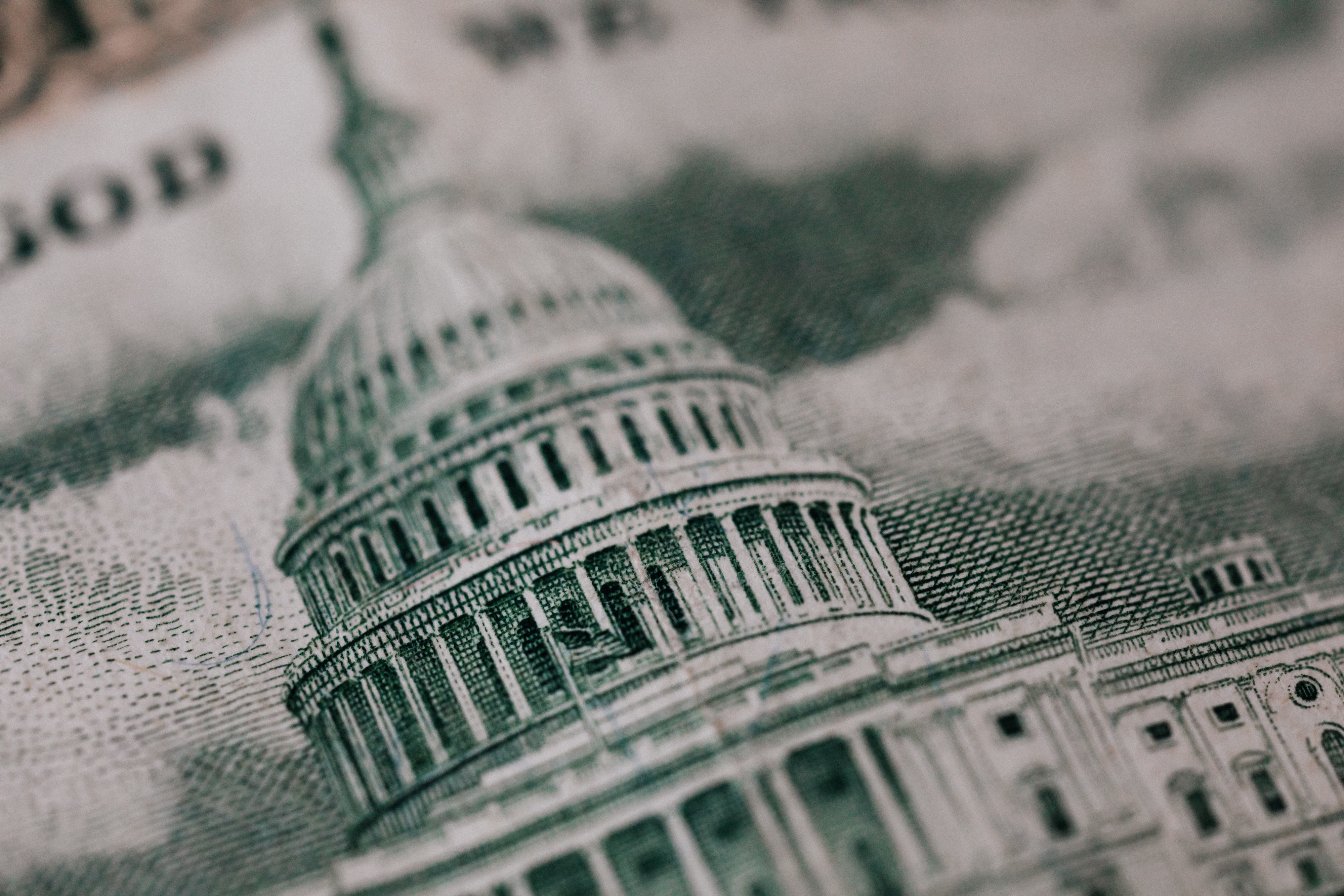 A close up of the capitol building on a dollar bill