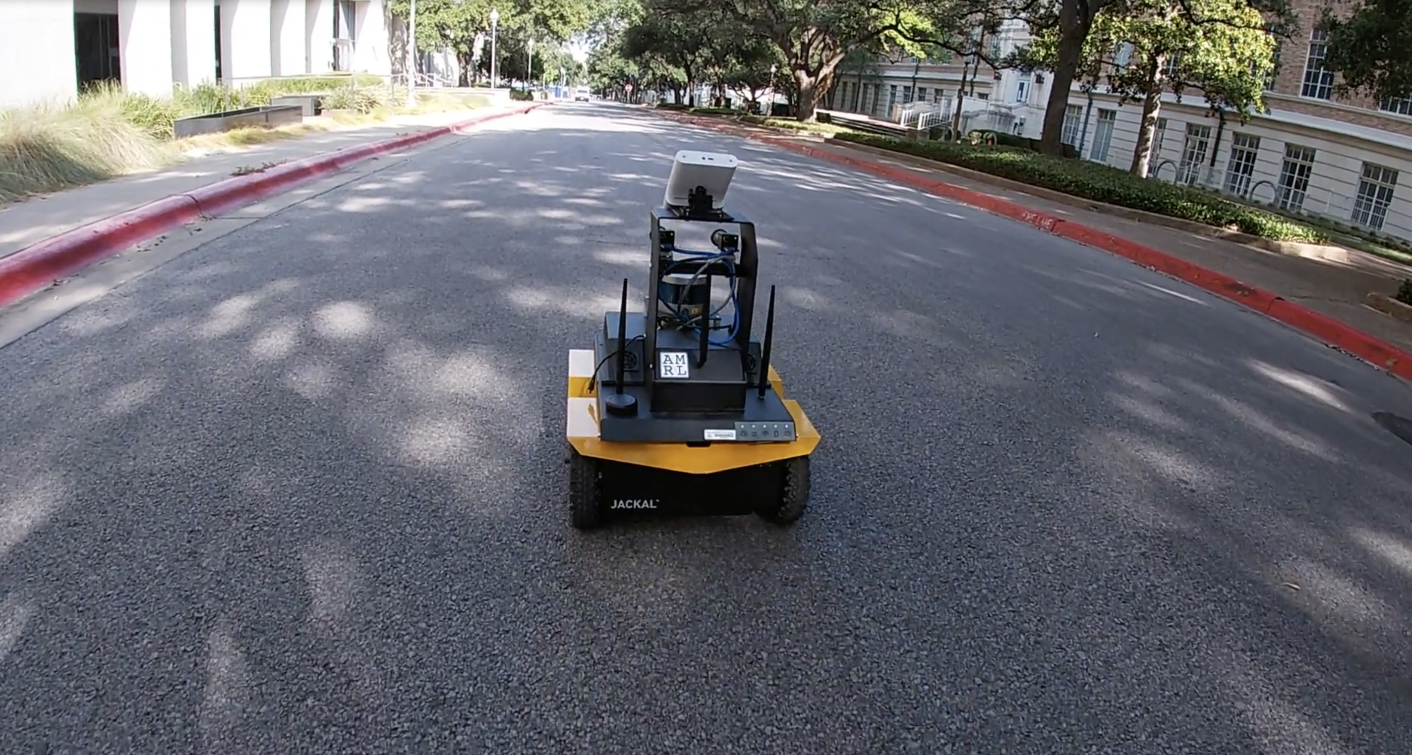 A Jackal robot delivers lemonade on The University of Texas at Austin campus.