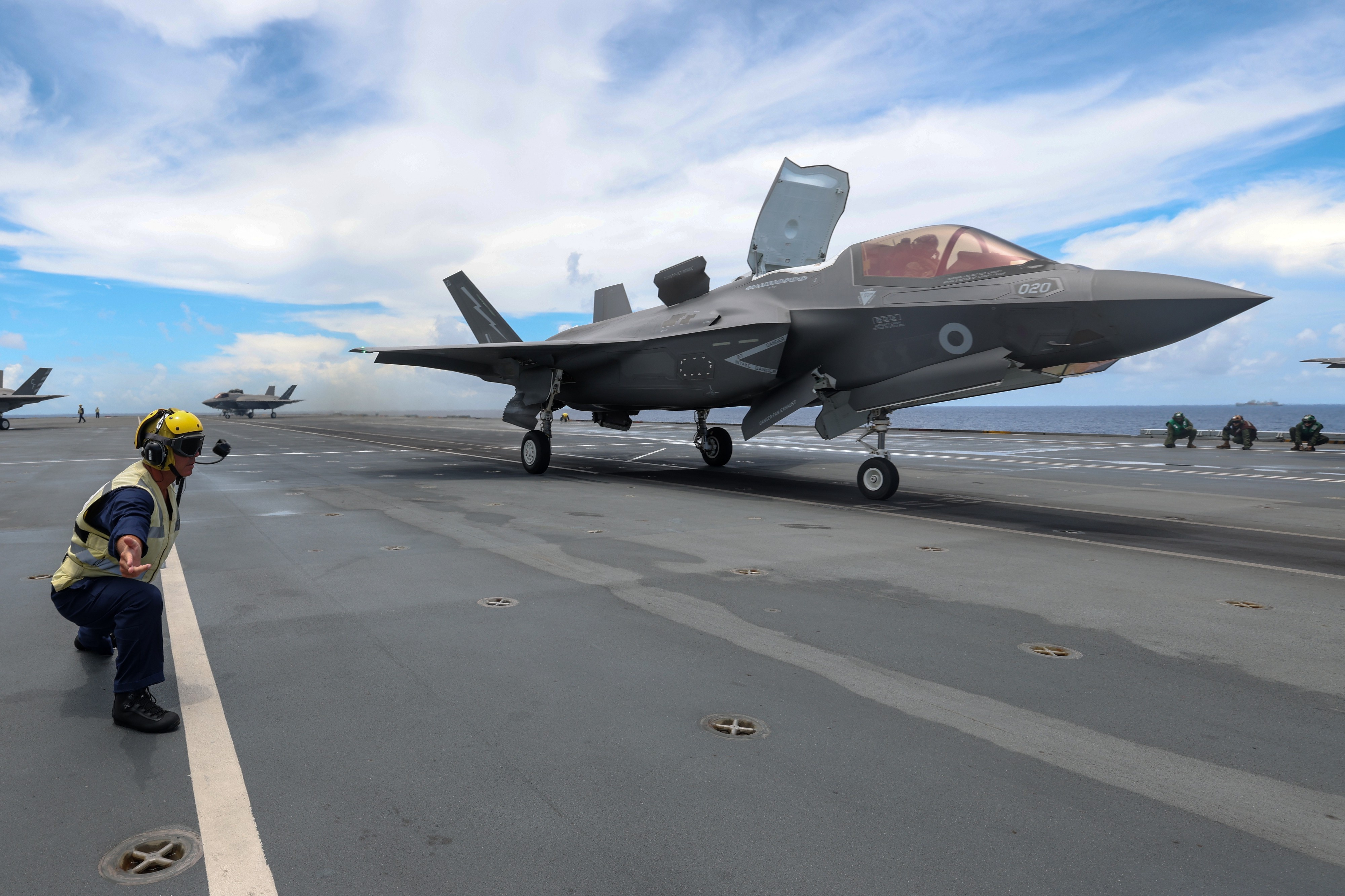 An F-35B fast jet takes off from the flight deck of HMS Queen Elizabeth.