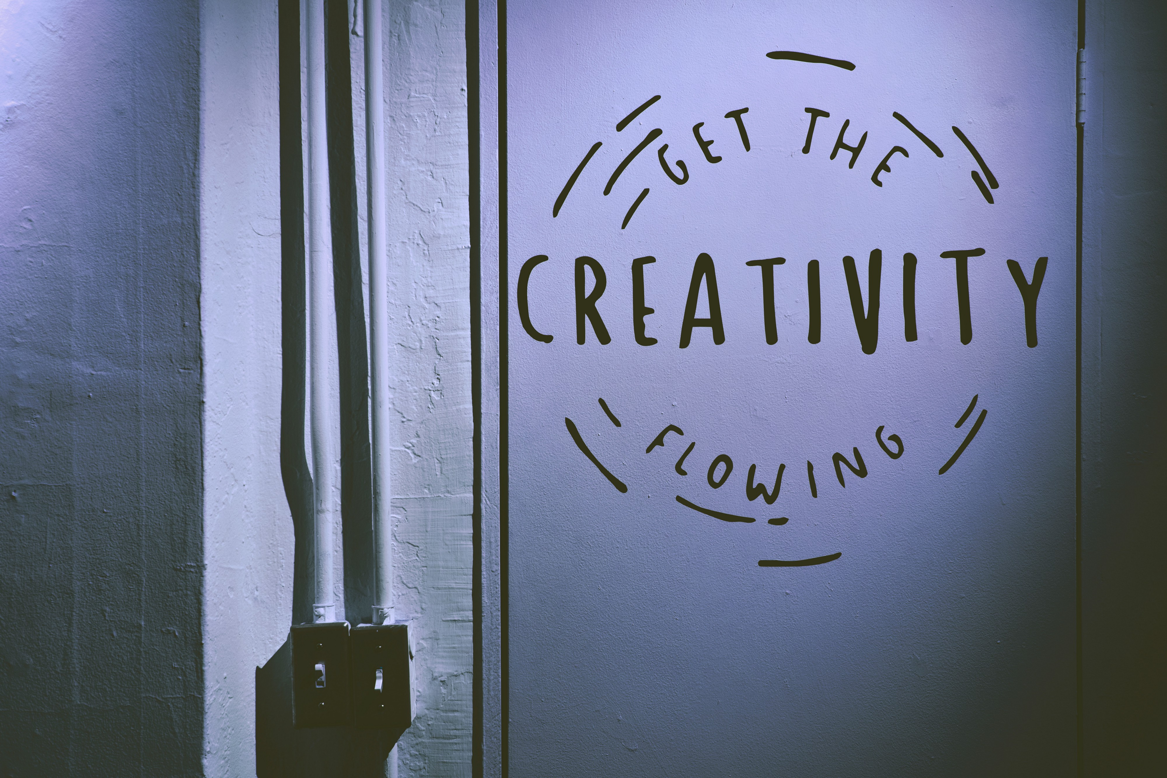 """Photo of a wall art reading """"get the creativity flowing"""""""