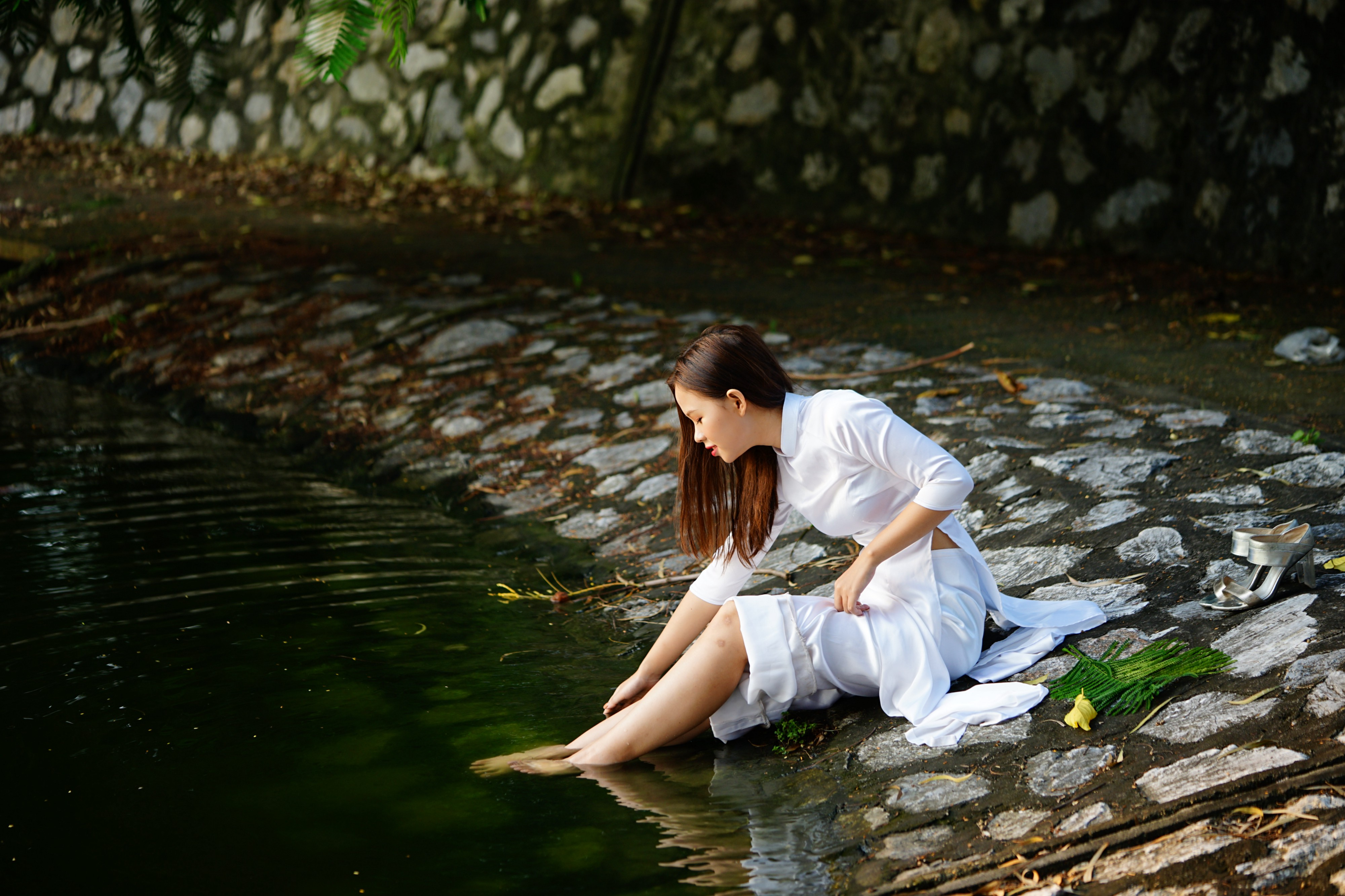A woman relaxing by the creek