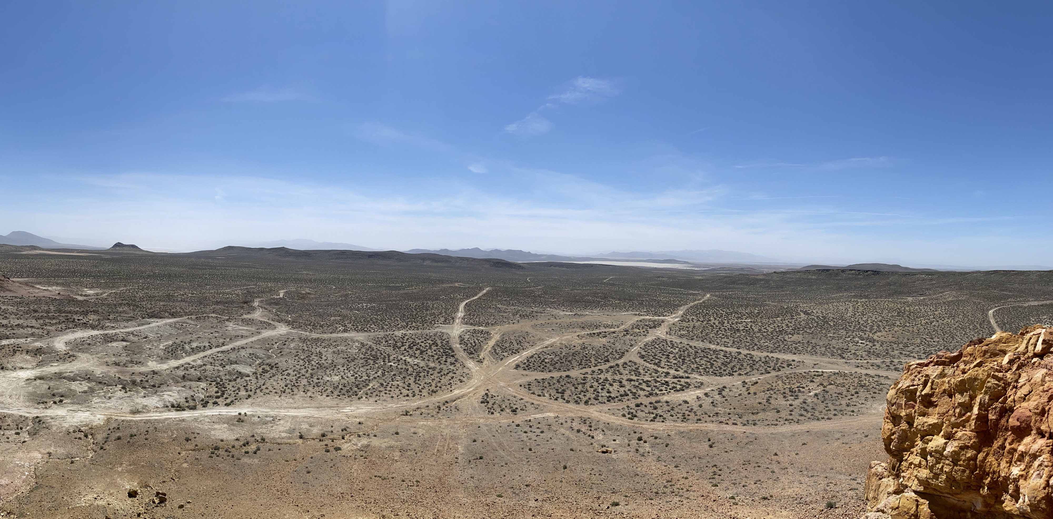 Photo of a desert landscape taken from the peak of a mountain.
