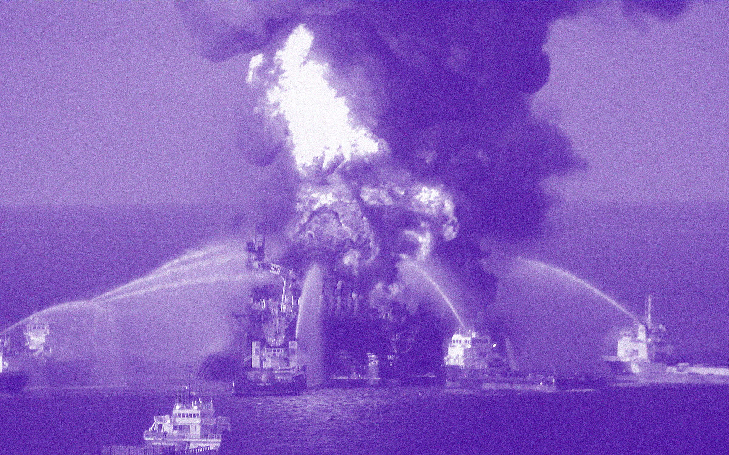 A photo illustration of the Deepwater Horizon oil rig in flames, with fire crews trying to put it out.