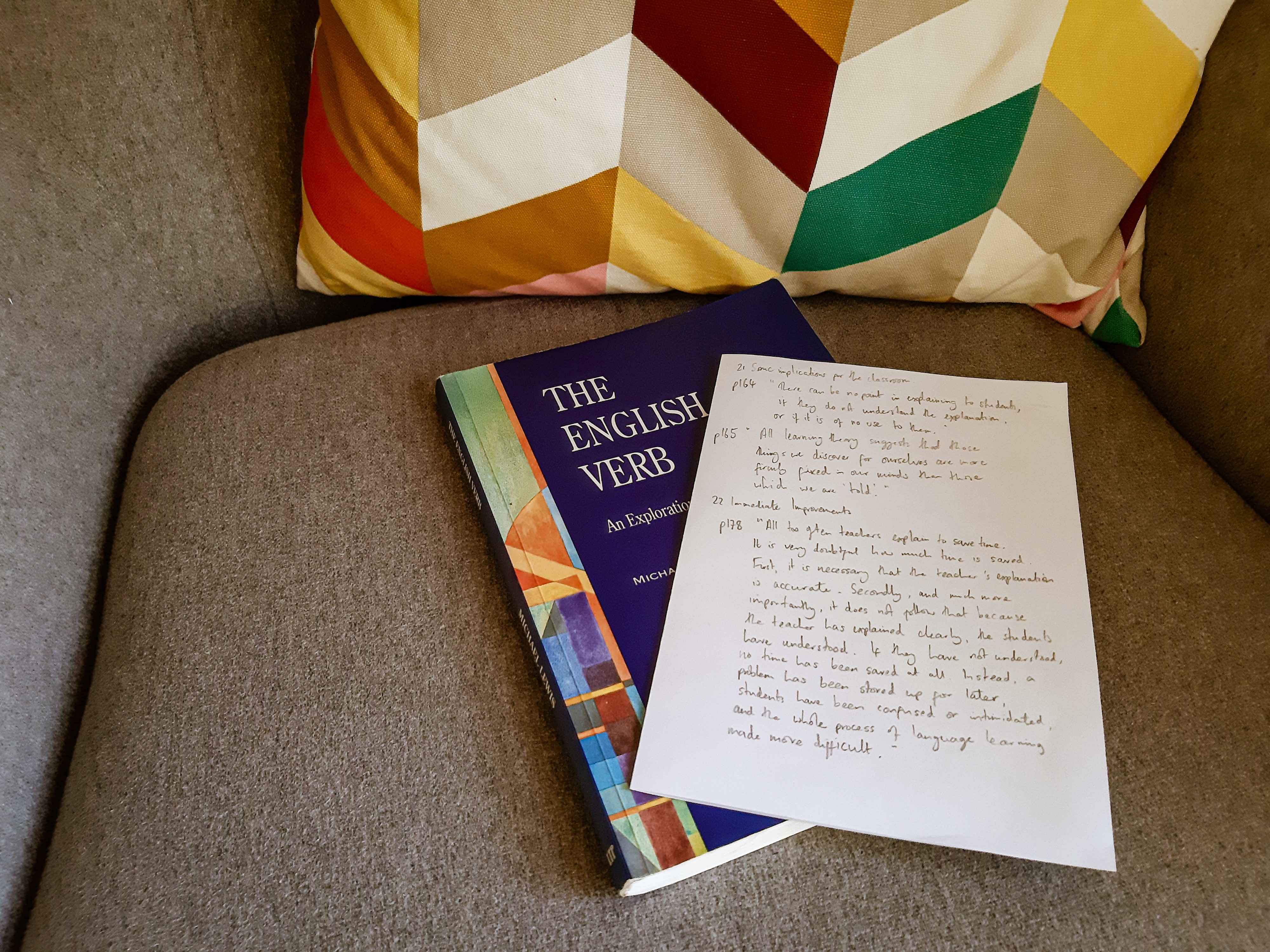 Cover of The English Verb by Michael Lewis with accompanying written notes.