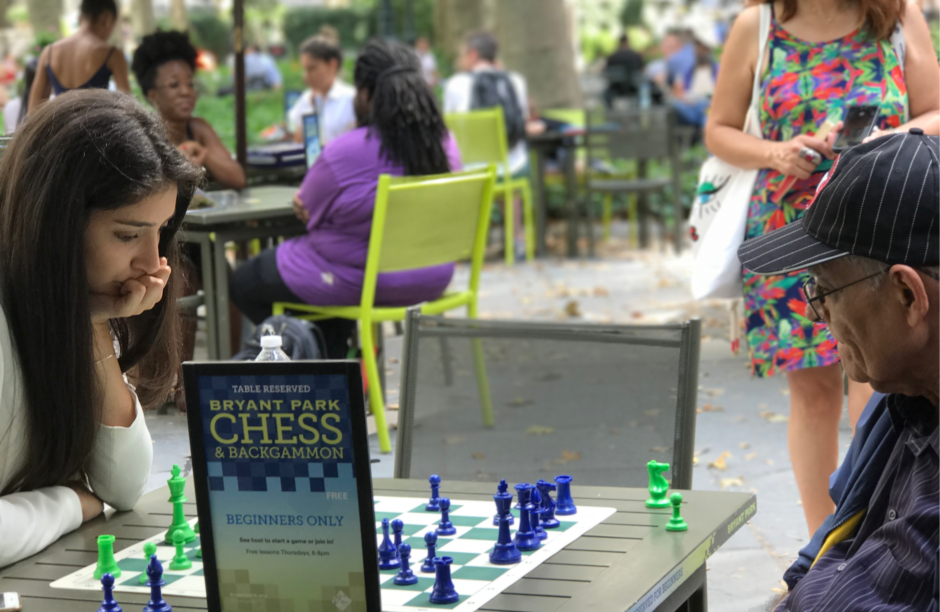 Watching a ches match in New York City's Bryant Park