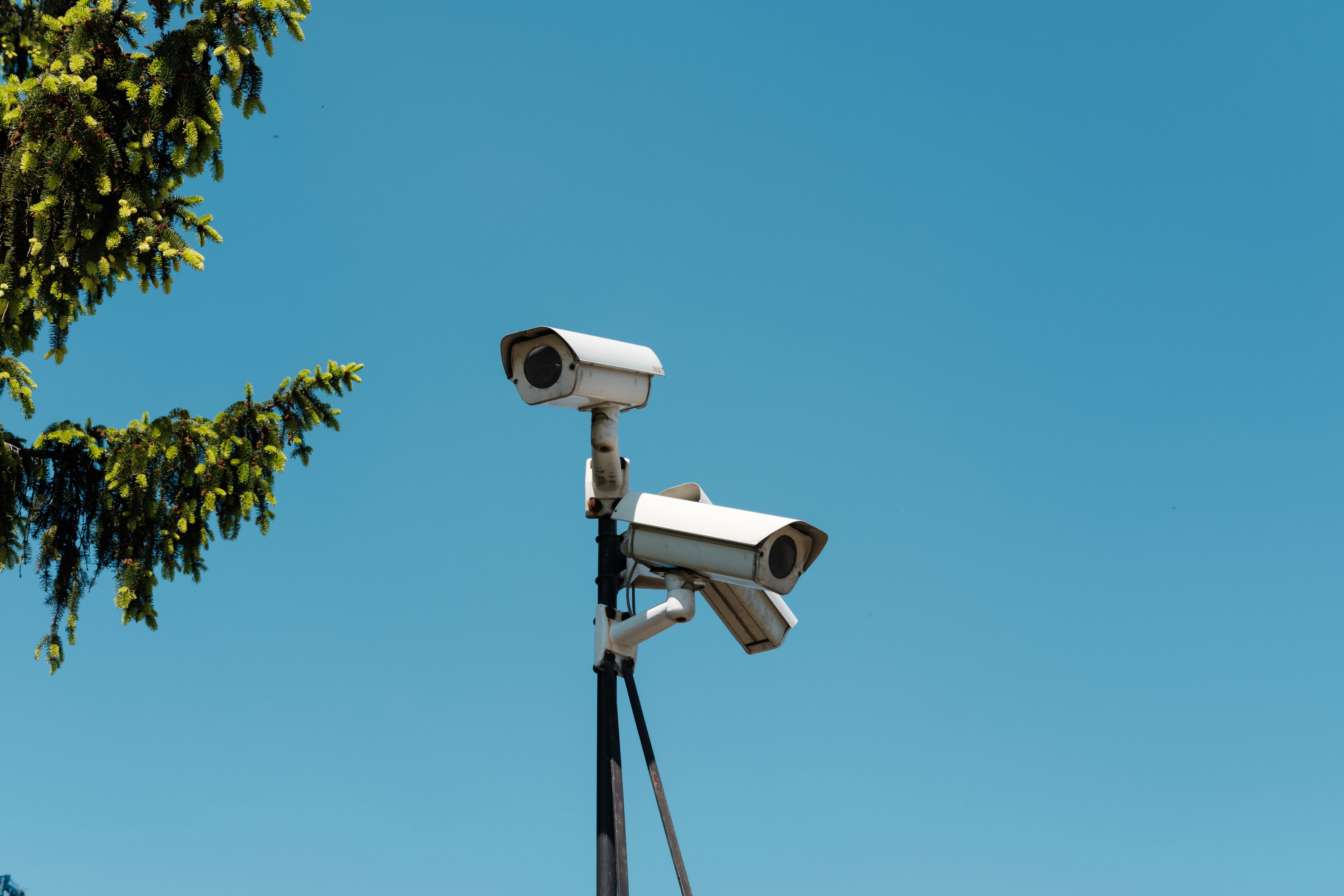 Two surveillance cameras collect video footage.