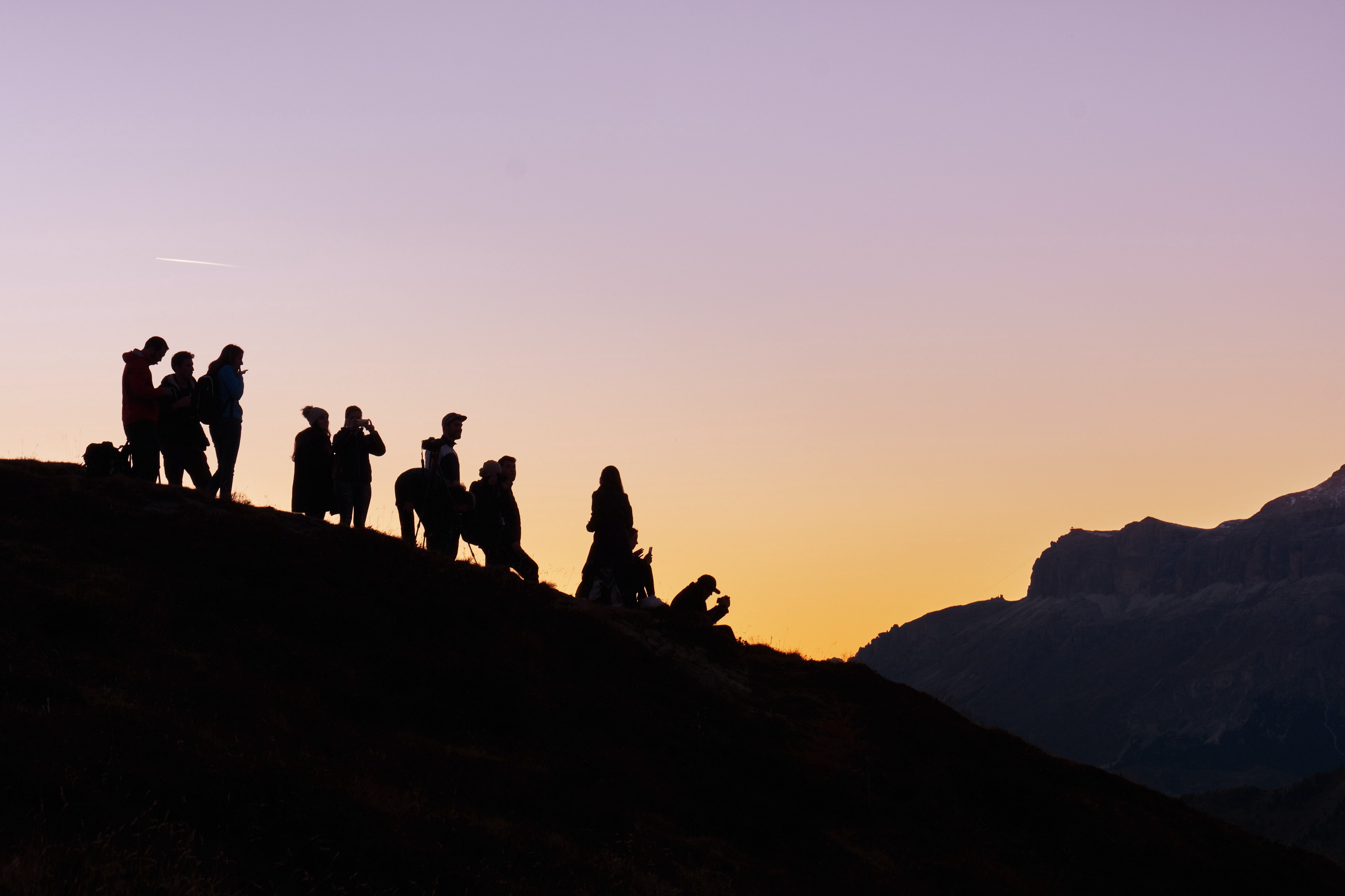 An image with people in the sunset