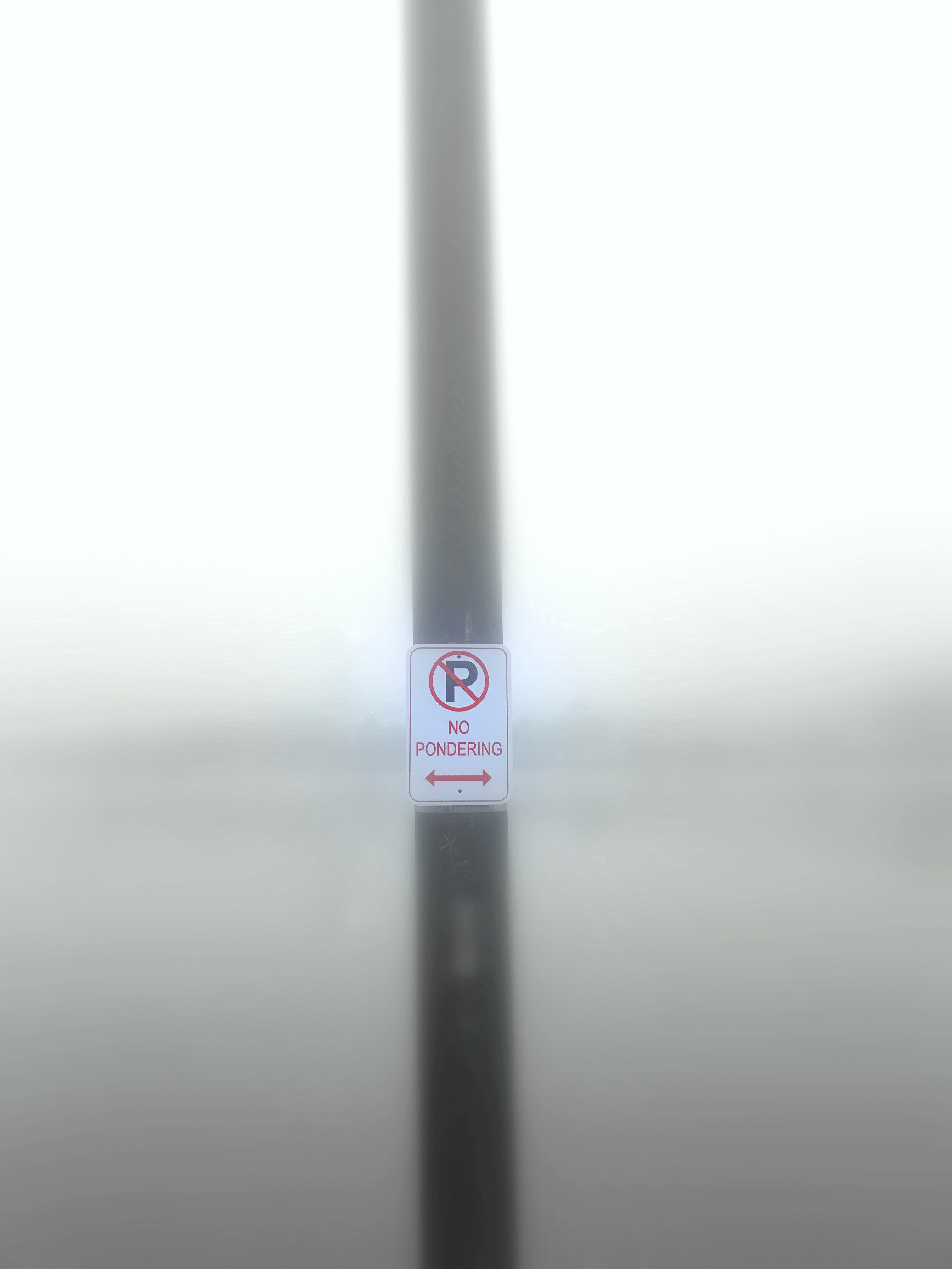 Photograph of my no pondering sign next to a heavily fogged bank