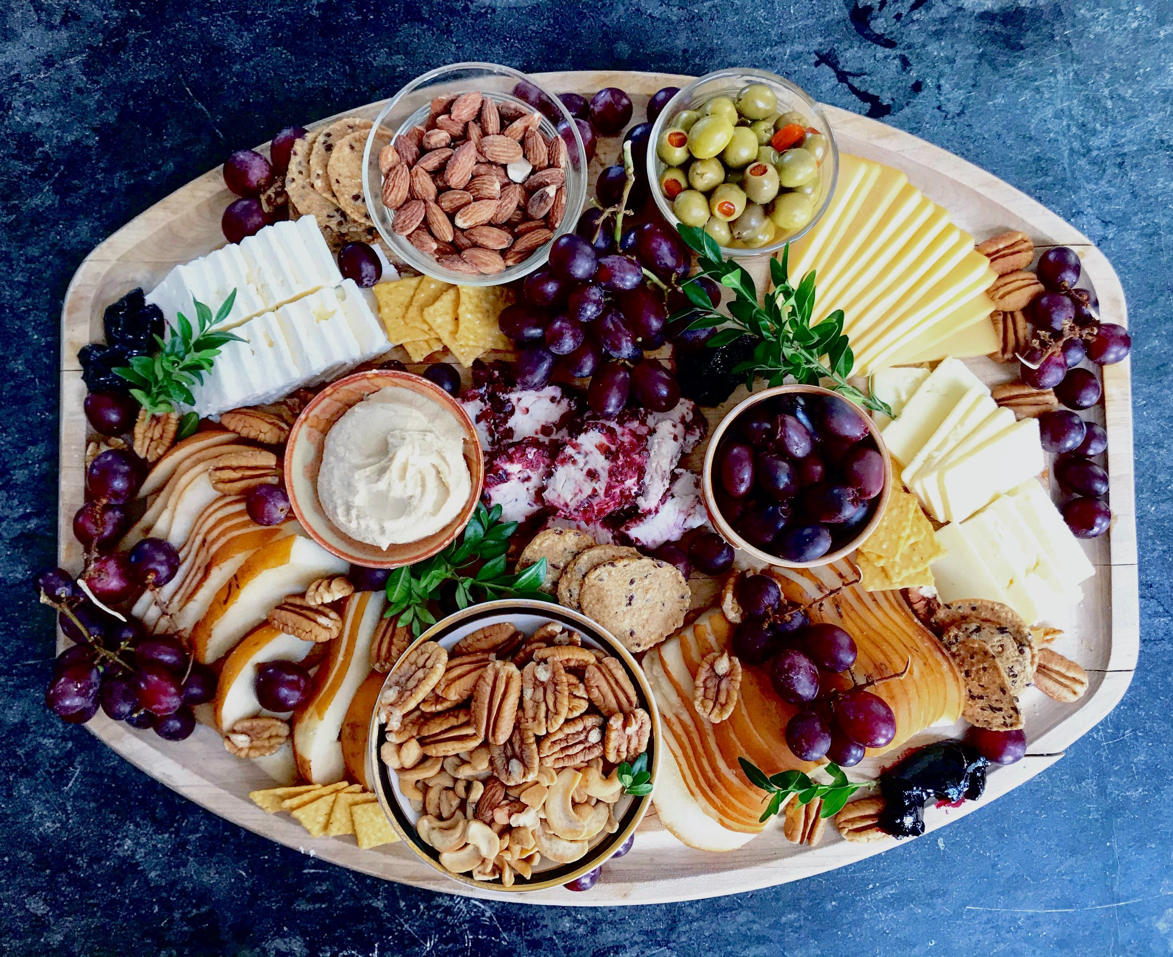 Food platter with cheese, olives and crackers