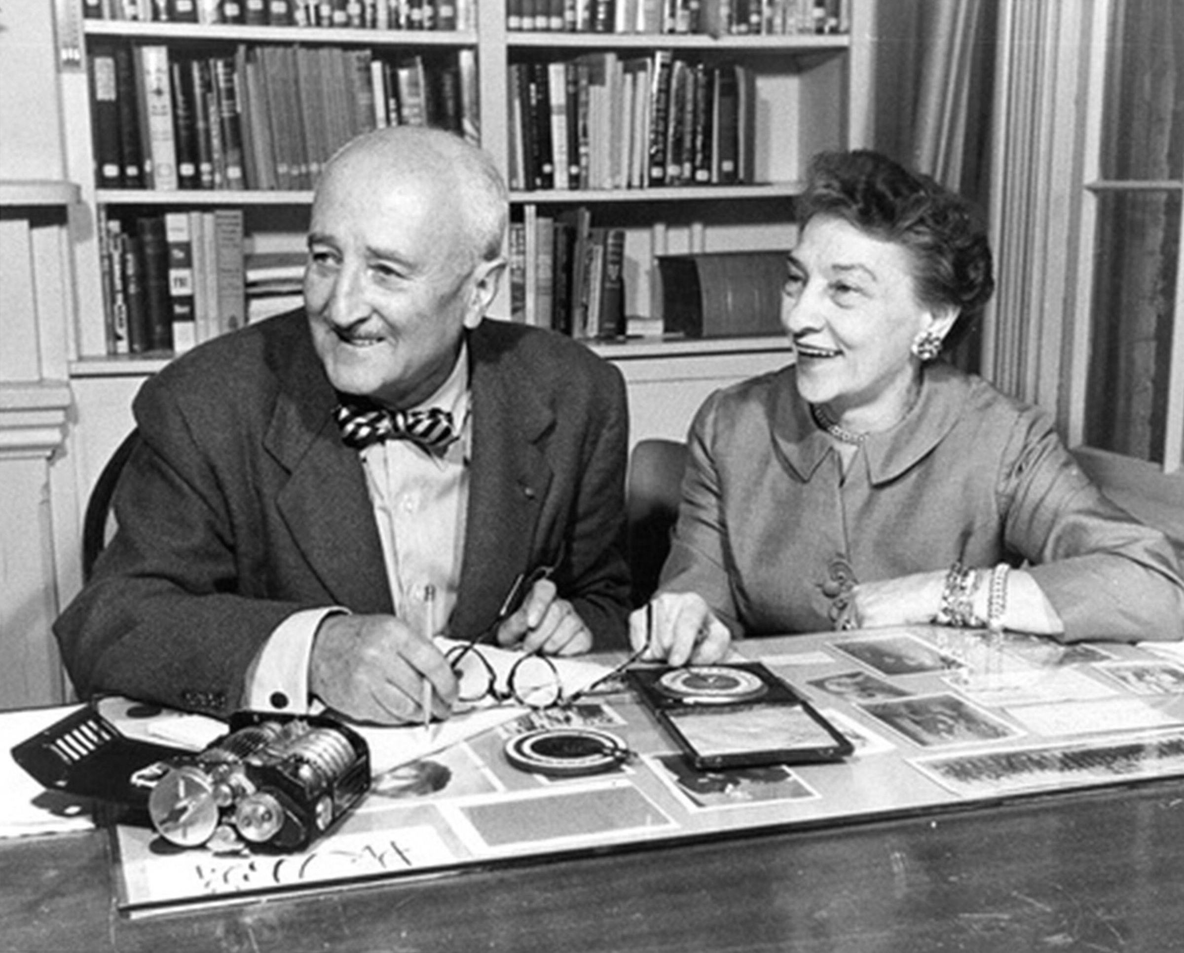 A smiling older couple stare off camera, laughing