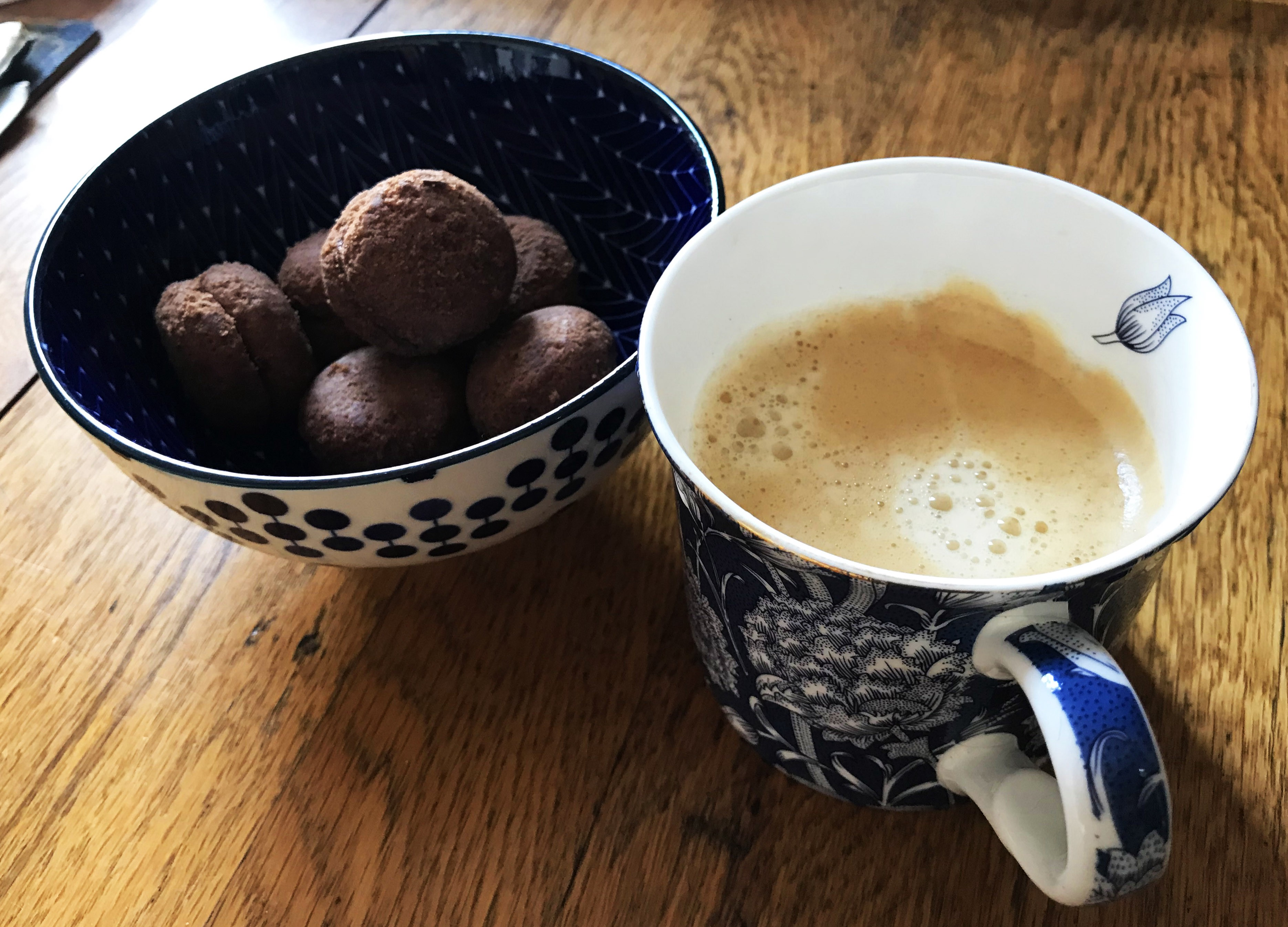 A cup of coffee and some Italian biscuits