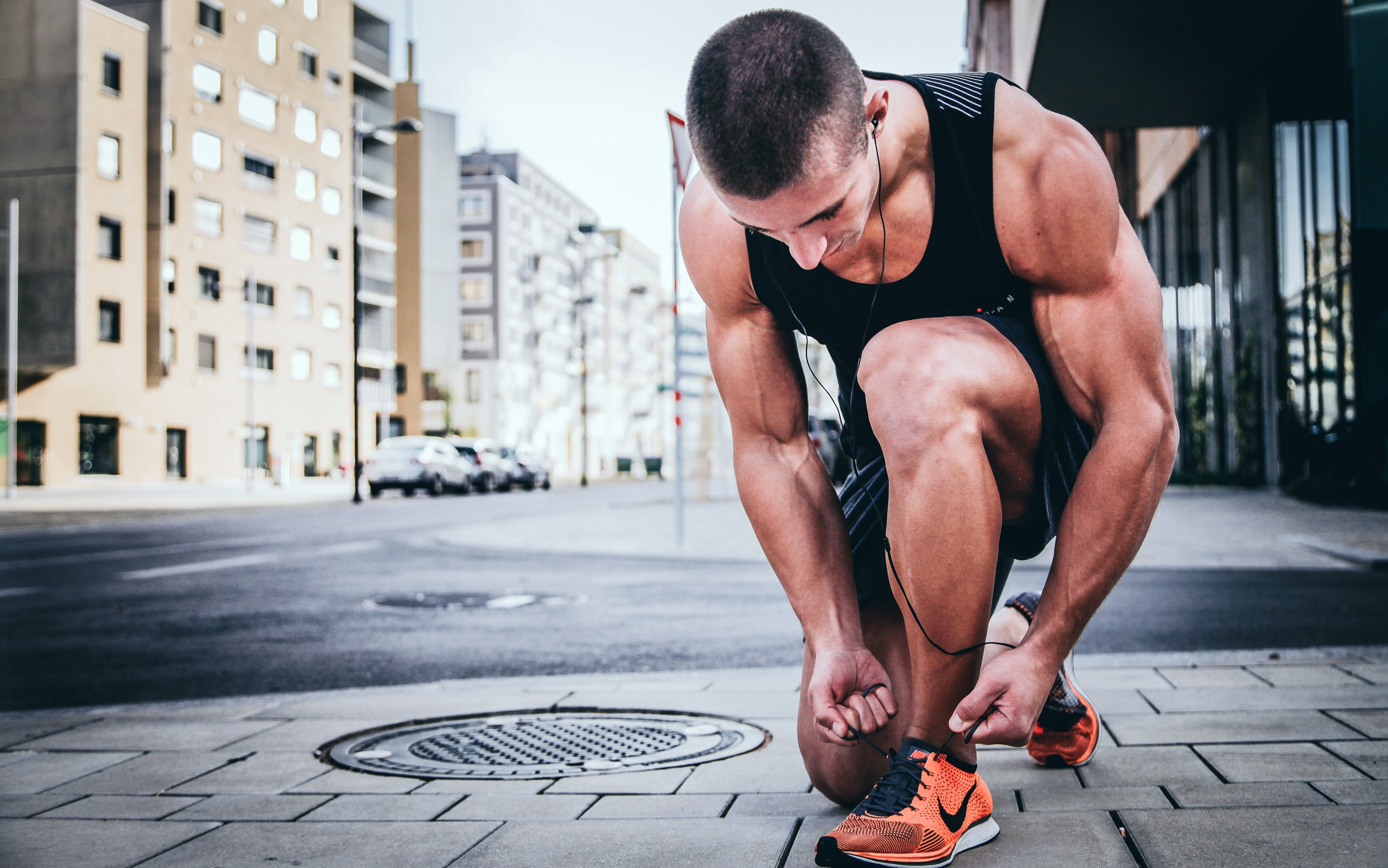 Man tying his shoes during a run