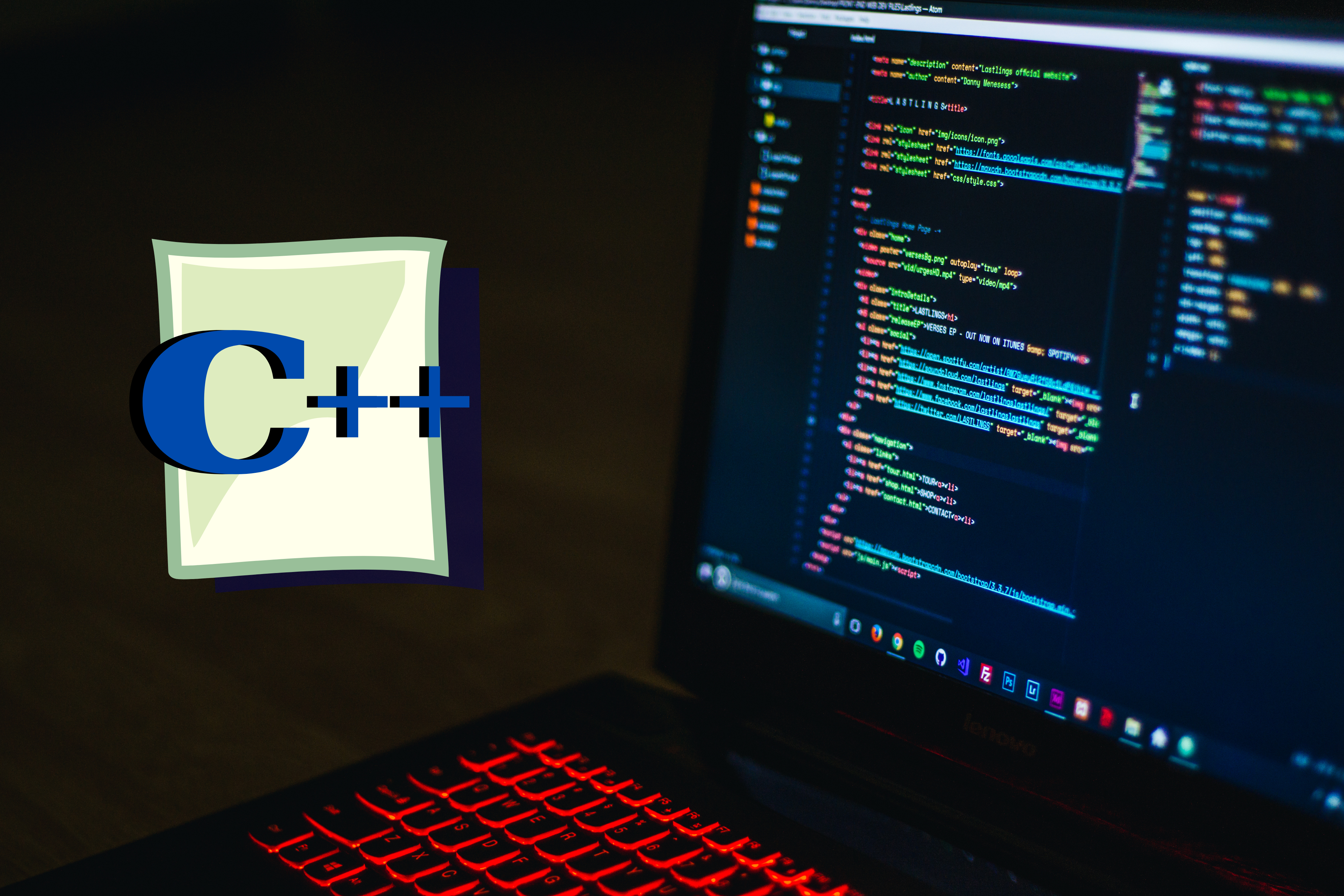 A laptop displays lines of codes with a c++ logo to its left.