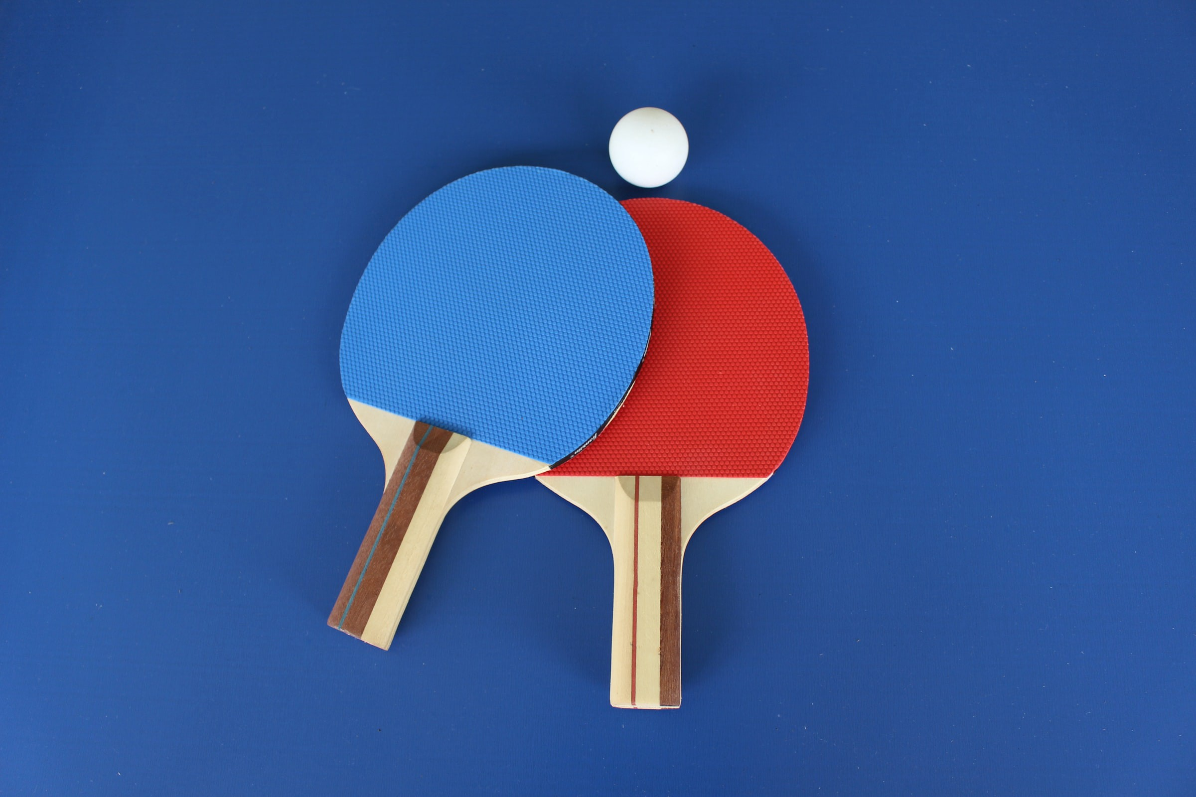 Red and blue ping pong paddles
