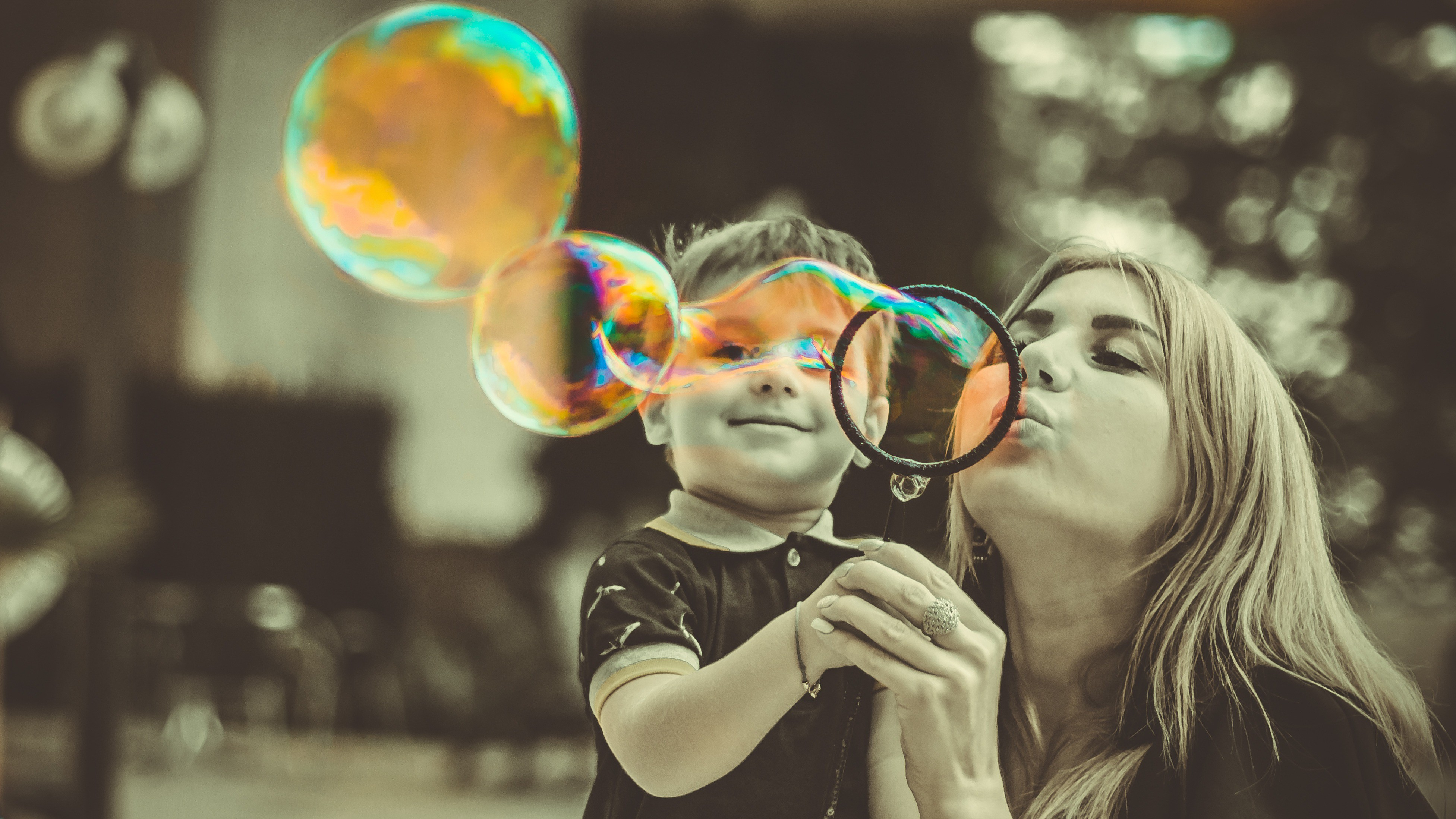 Mother and son playing bubbles