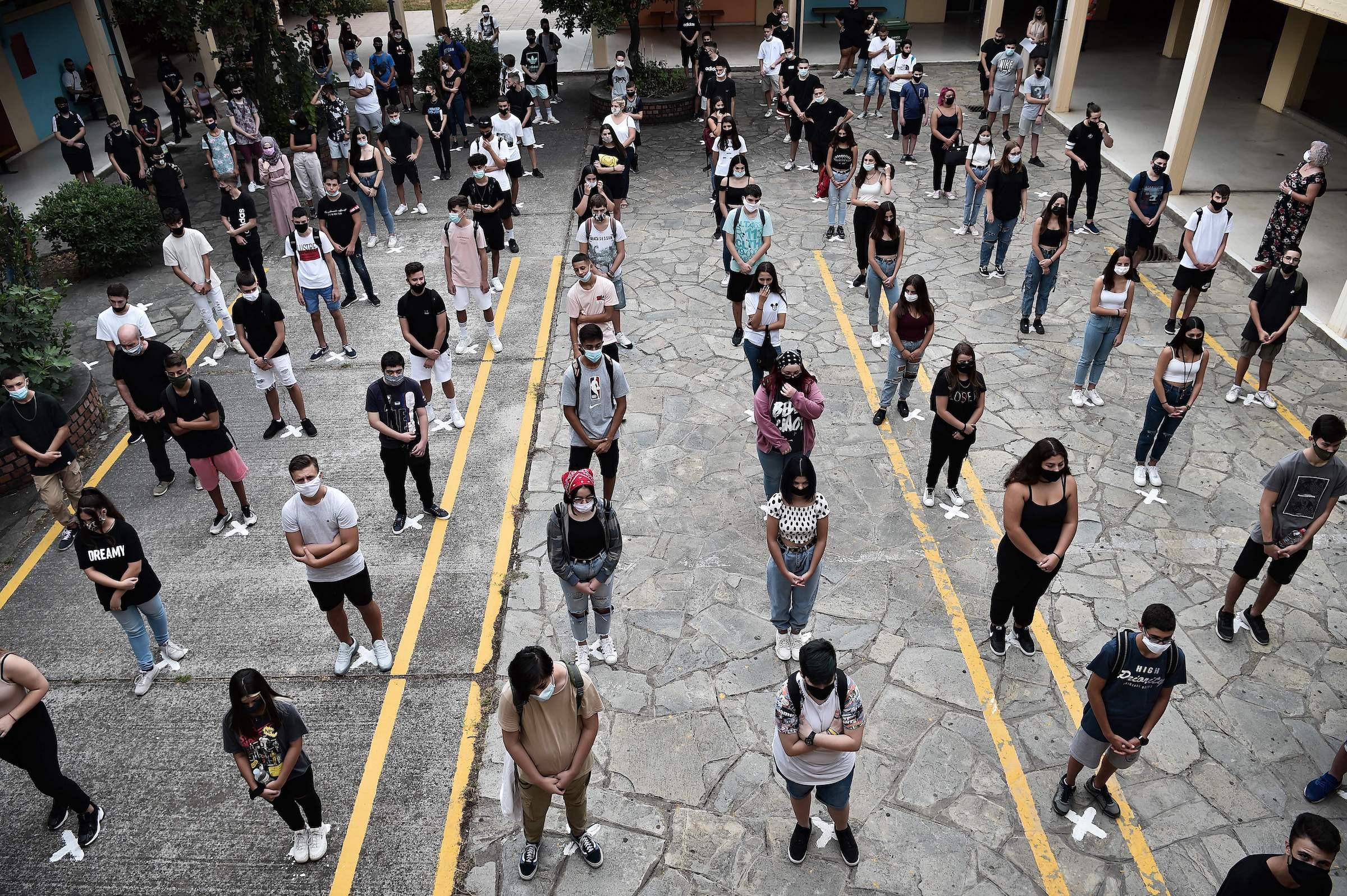 High school students standing in a socially distanced grid in an outdoor setting.