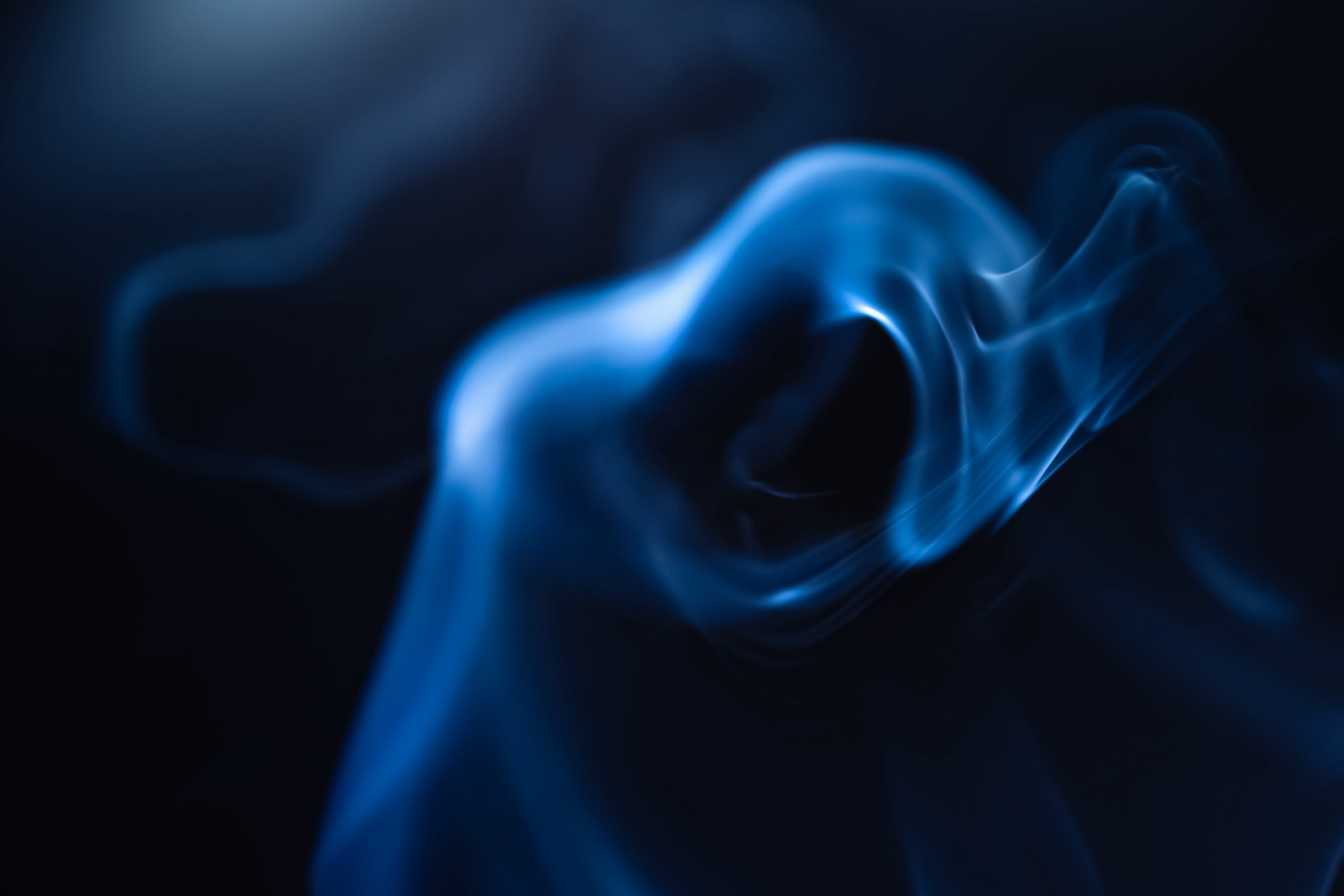 Image of a cloud of smoke against a dark background