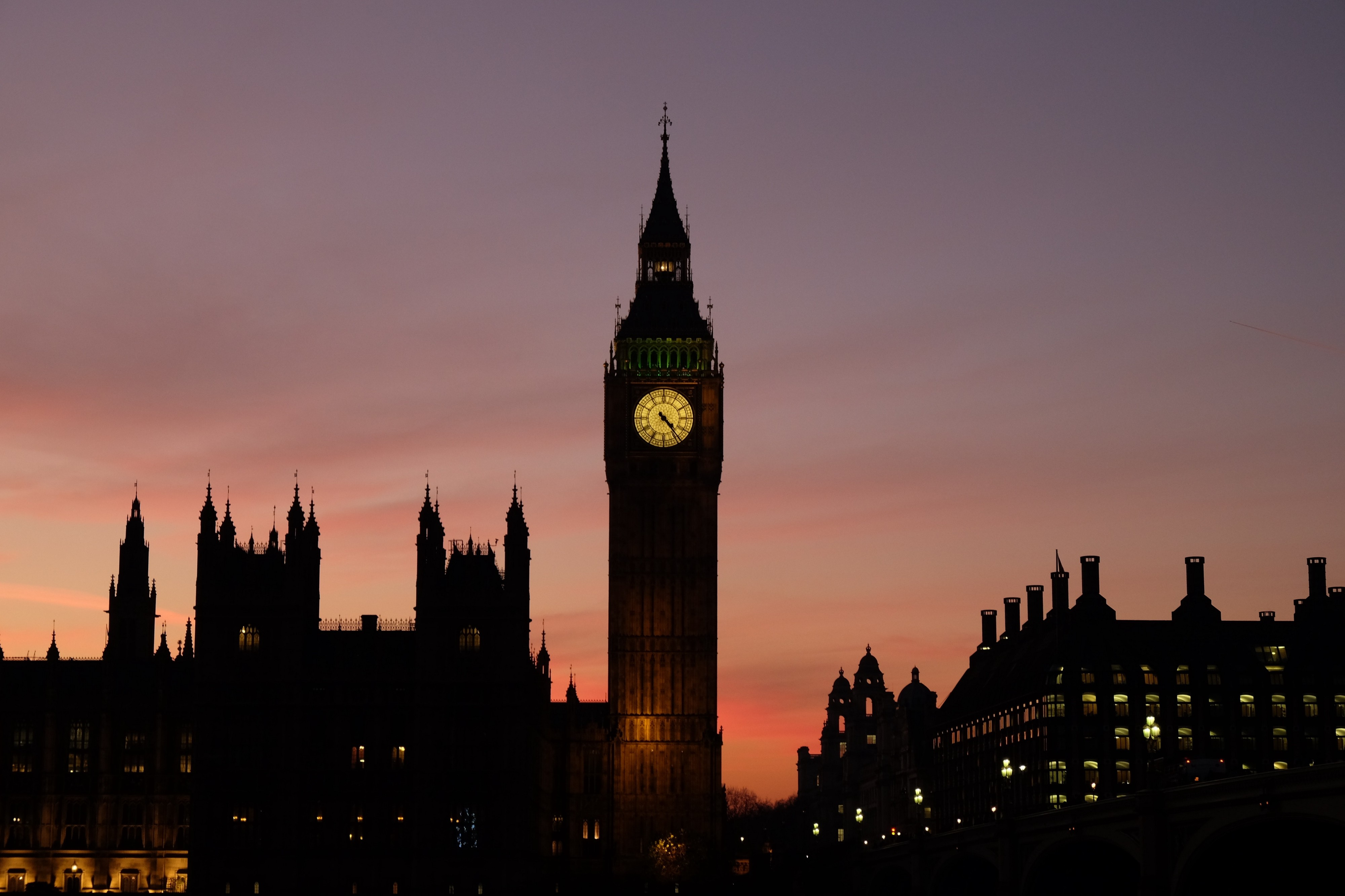 A shot of the Elizabeth Tower, known as Big Ben, and the Houses of Parliament, at dusk.