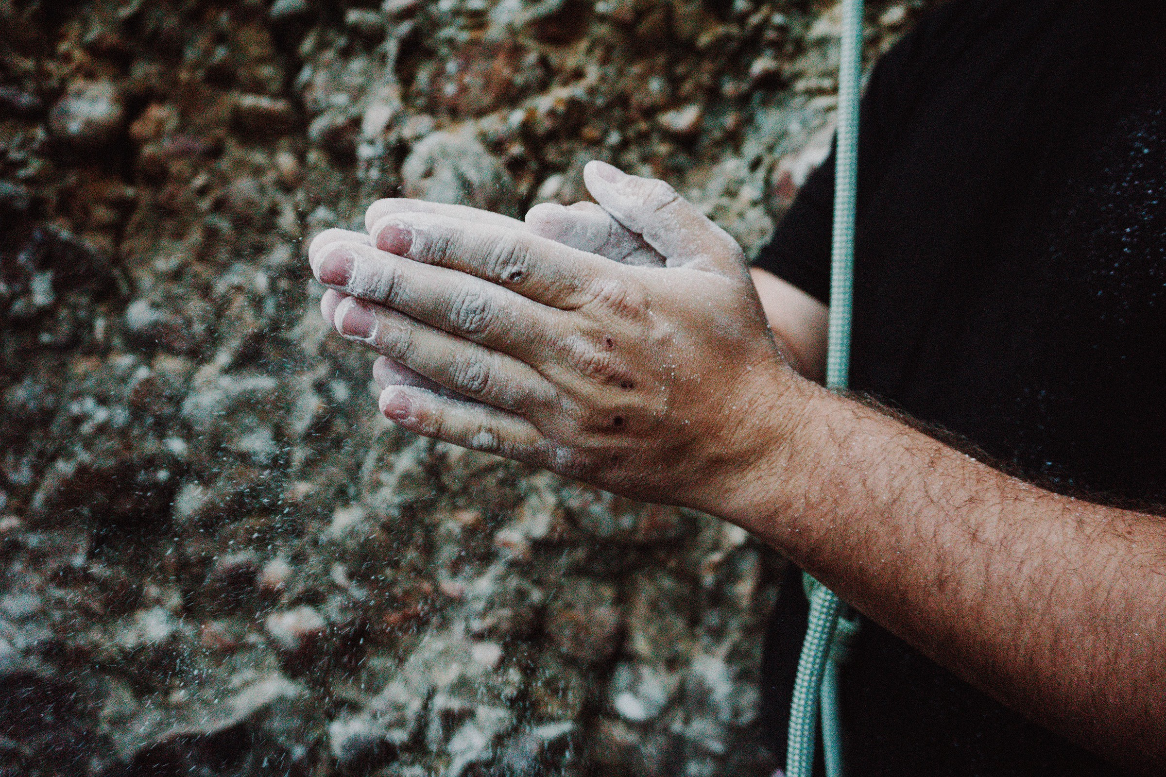 Rock climber's hands cover with chalk.
