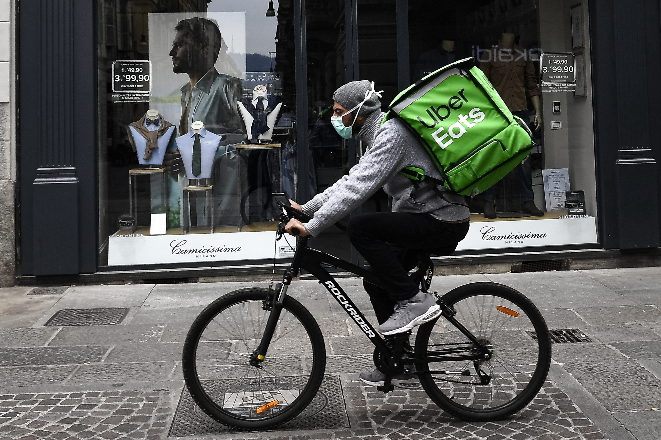 An UberEats delivery-person on a bike.