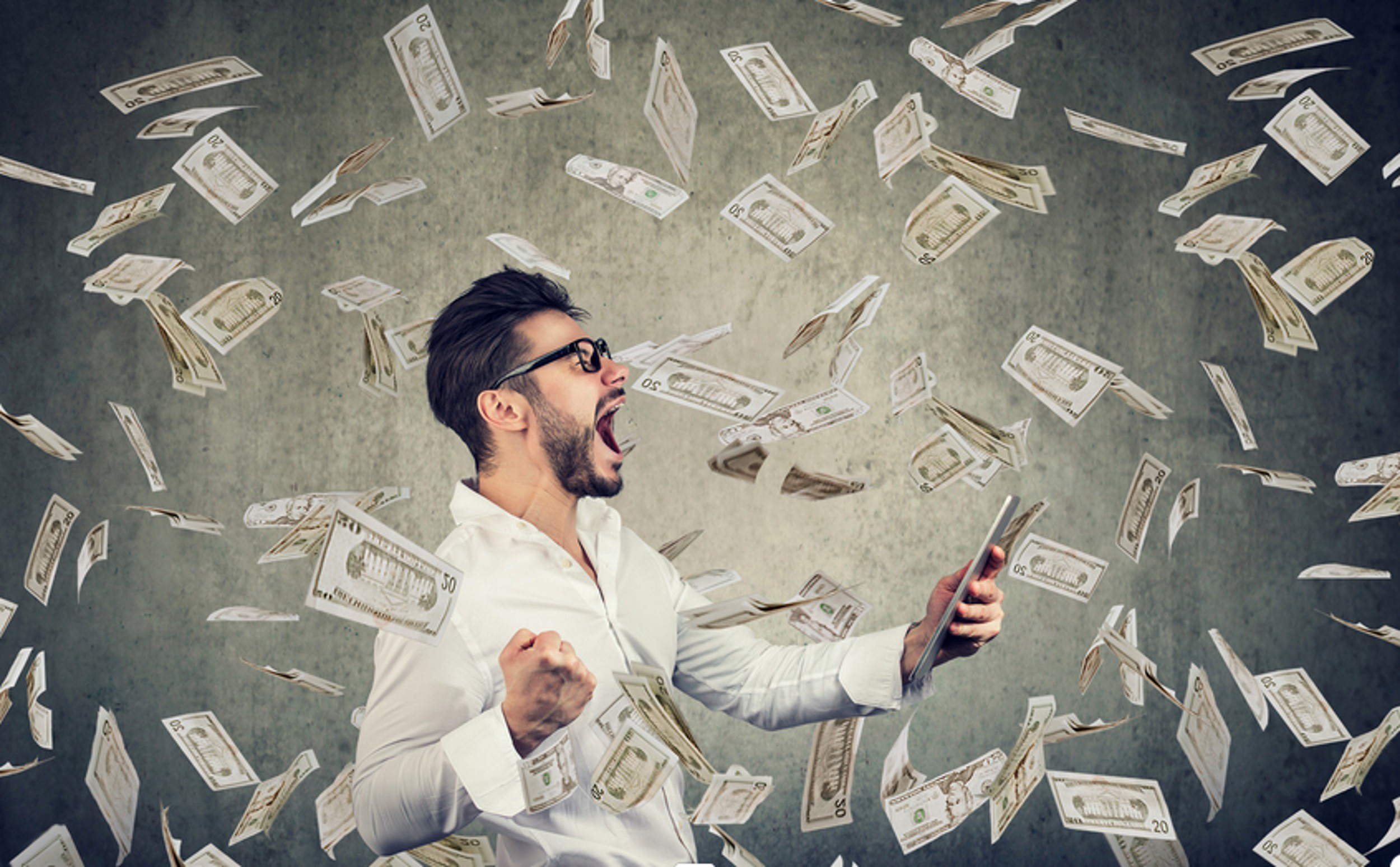 Photo of money flying and man screaming excitedly