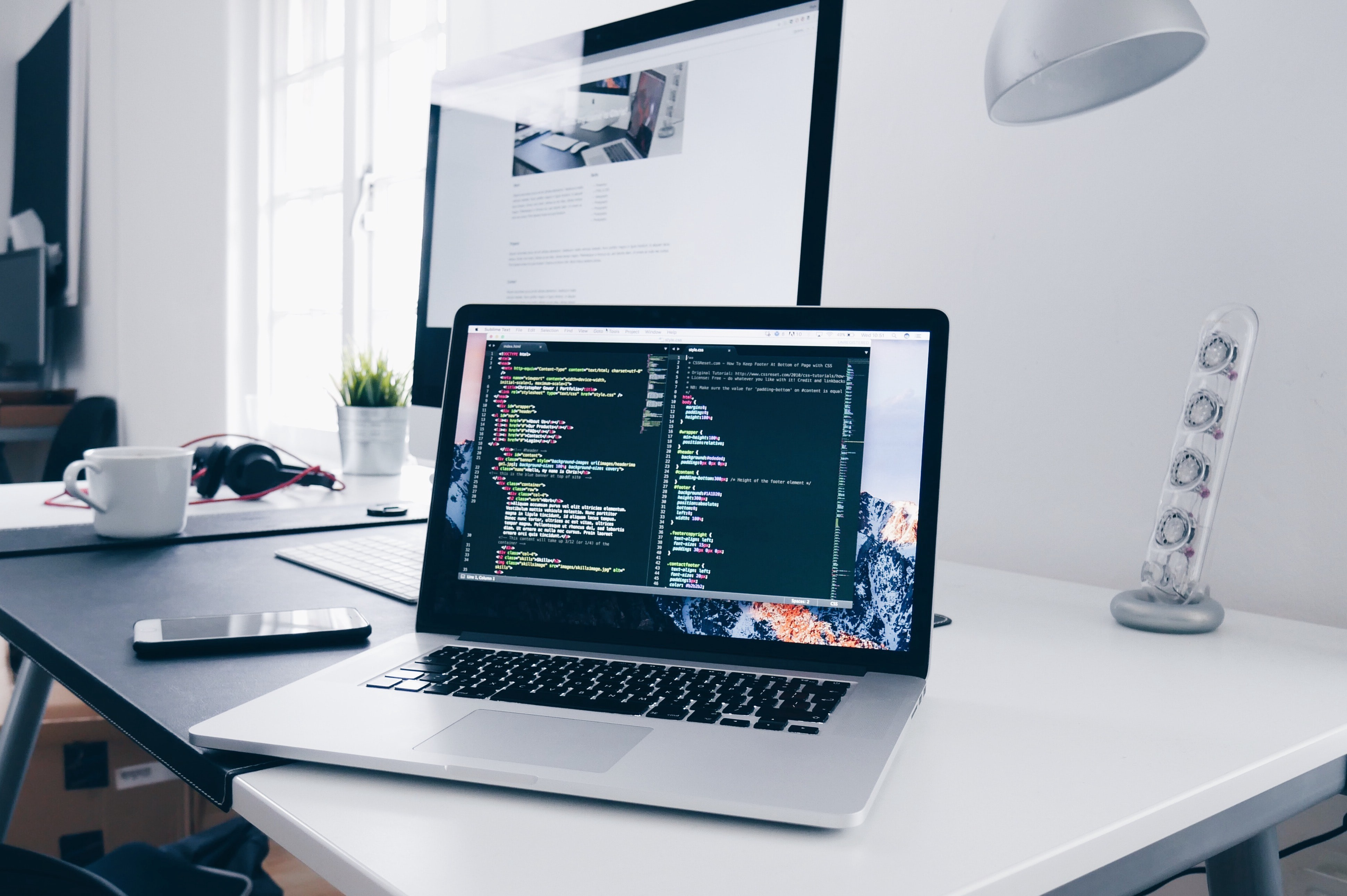 A laptop on a white desk—ready for learning Python programming through a great free online course