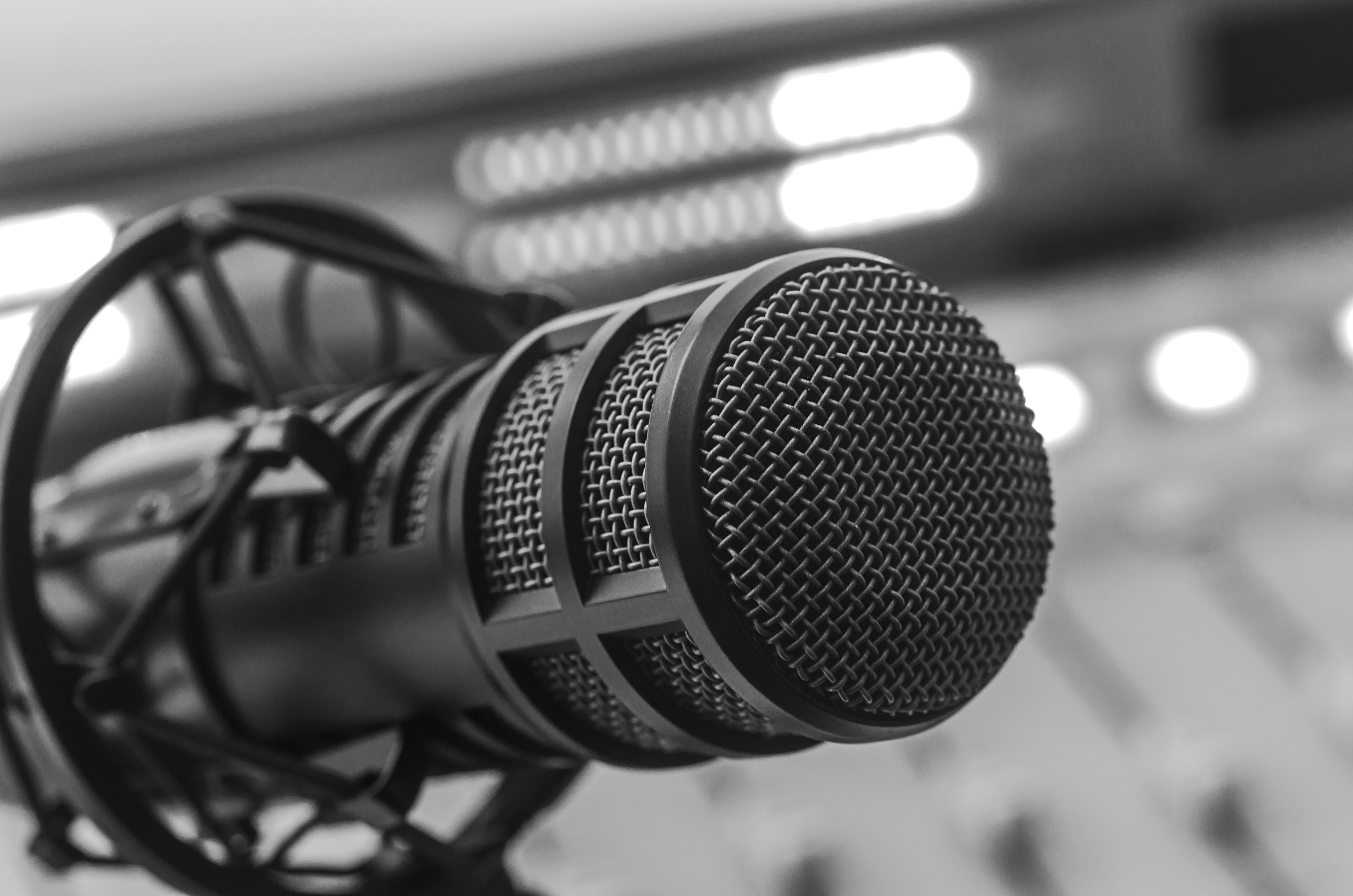 Close up of a microphone and audio console in a radio studio.