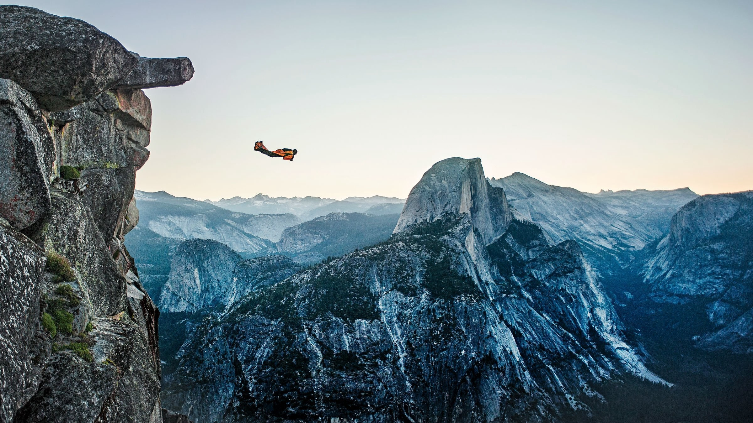 Wingsuit flyer taking off from a cliff