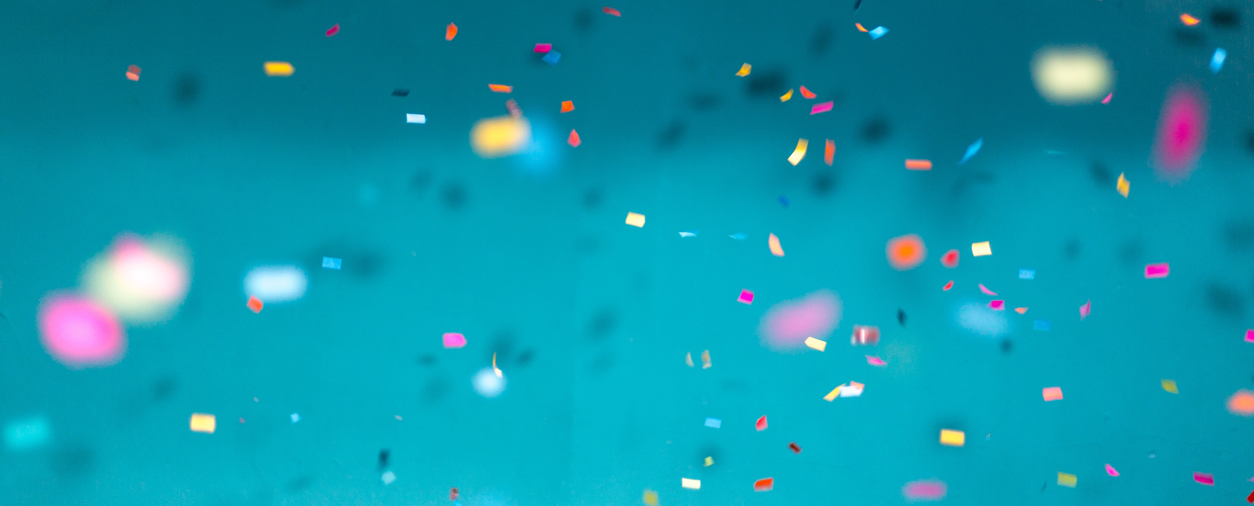 Paper colourful confetti floating in the air