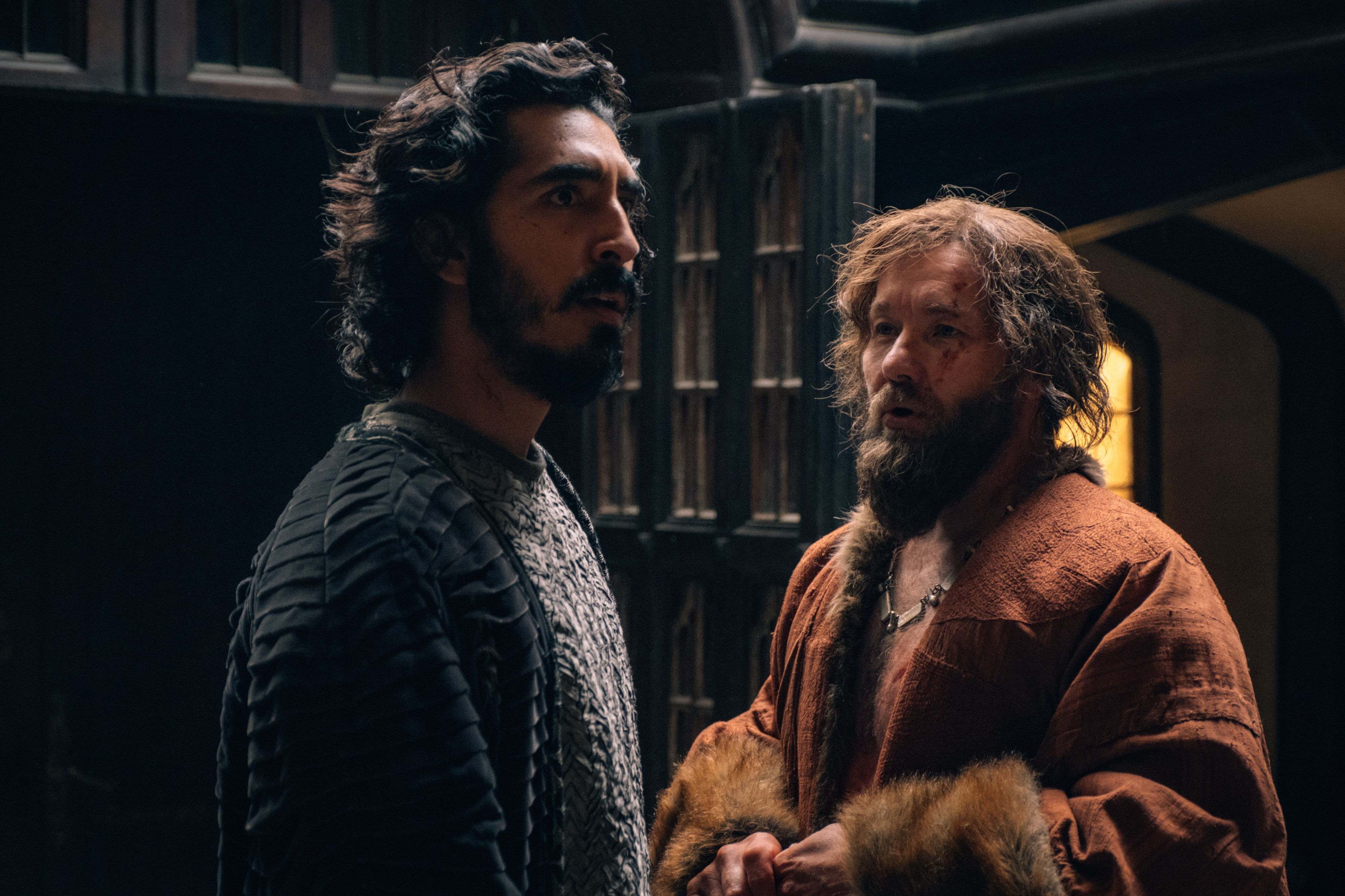 Dev Patel is hit on by a polyamorous lord, played by Joel Edgerton.