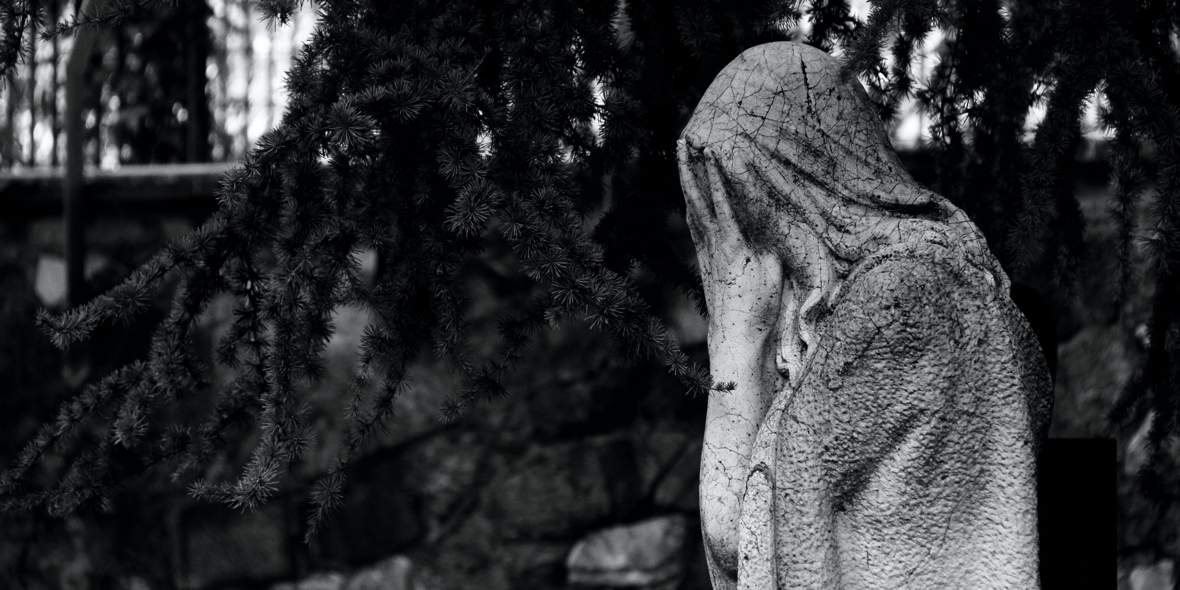 Picture of a statue weeping—Photo by Jens Aber on Unsplash