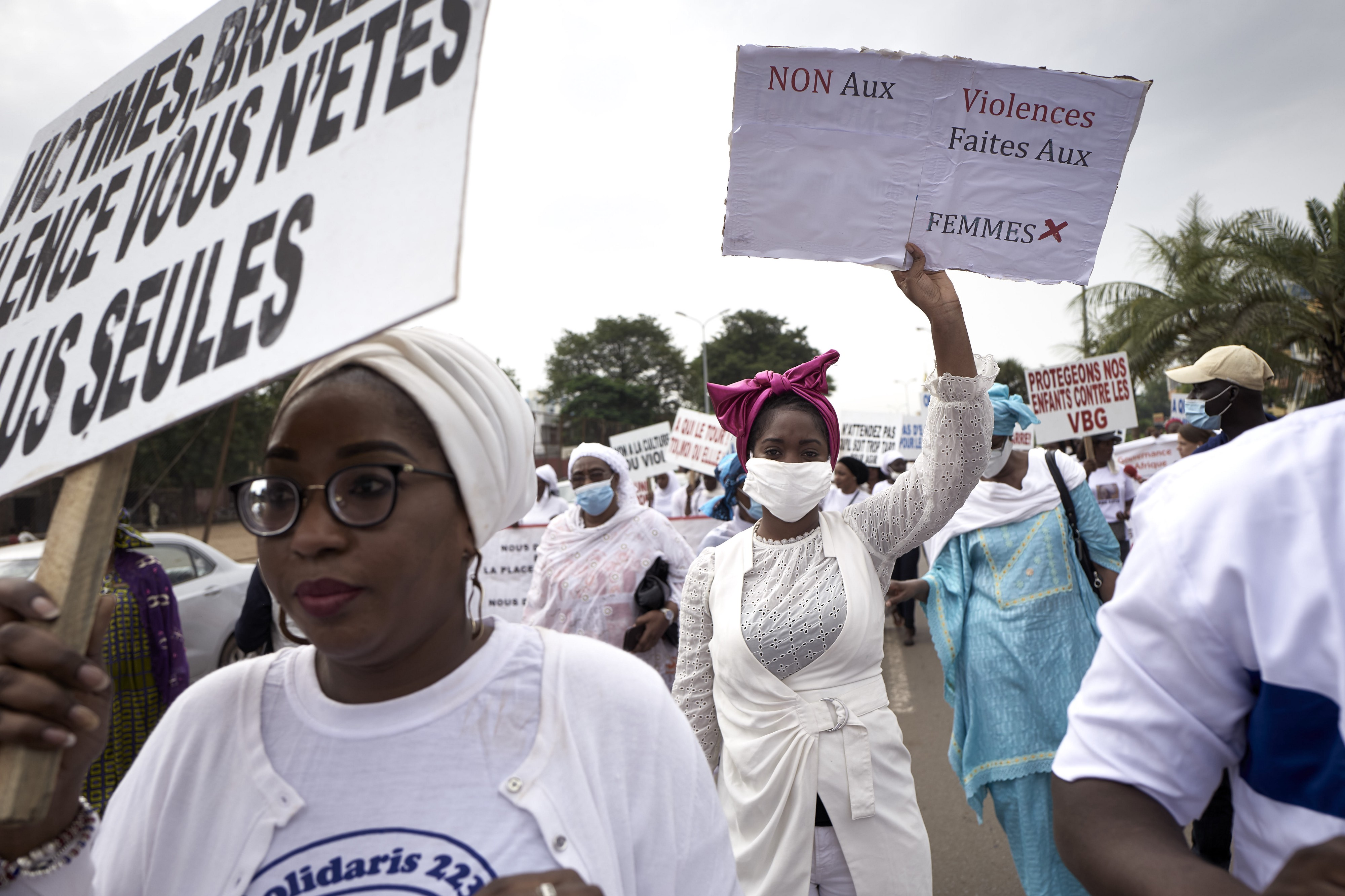 """A woman holds a placard reading """"No to violence against women"""" in Bamako on Saturday 26, 2020, during a demonstration against violence against women in Mali."""