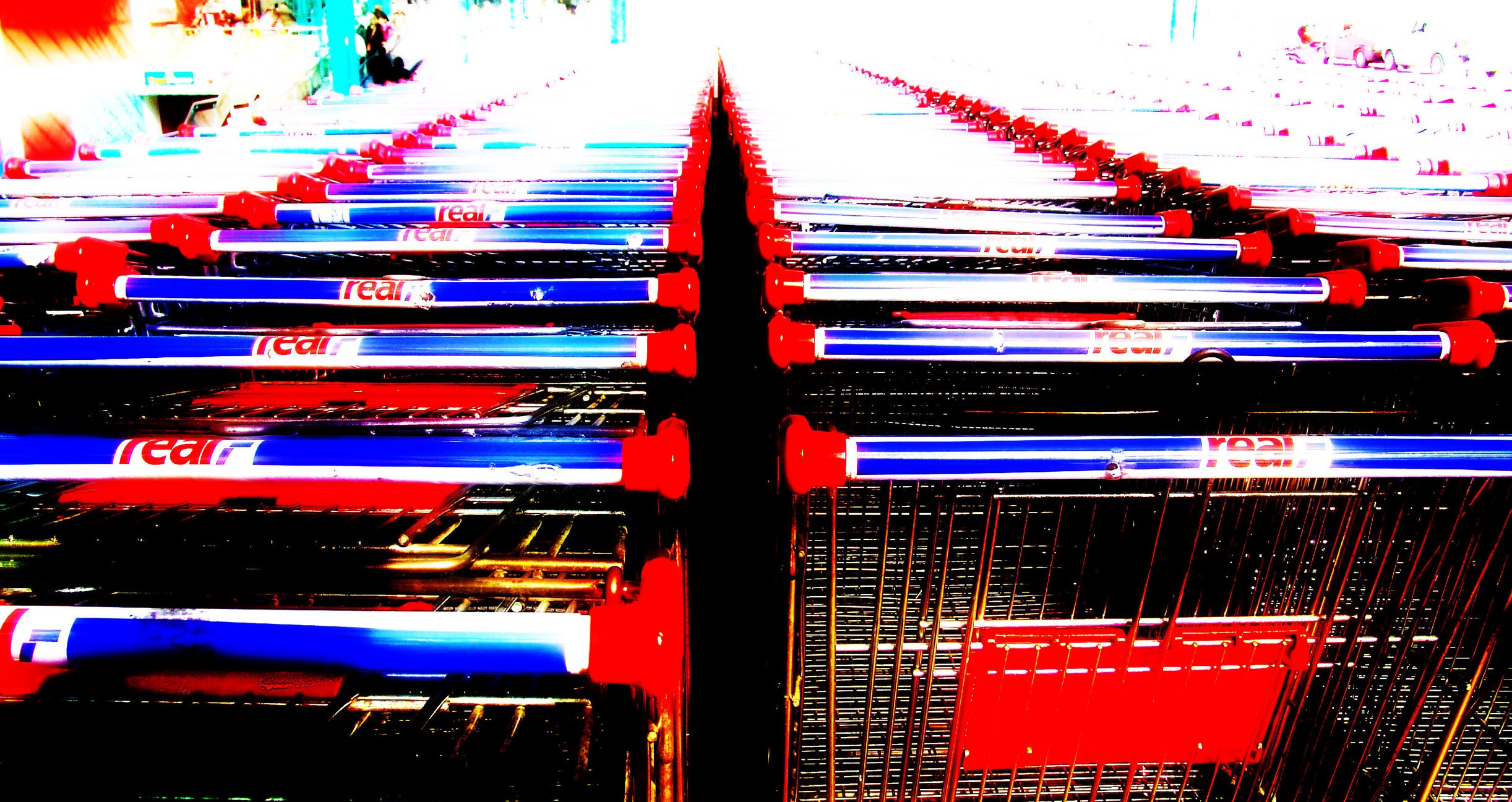 Hundreds of shopping carts lined up neatly.