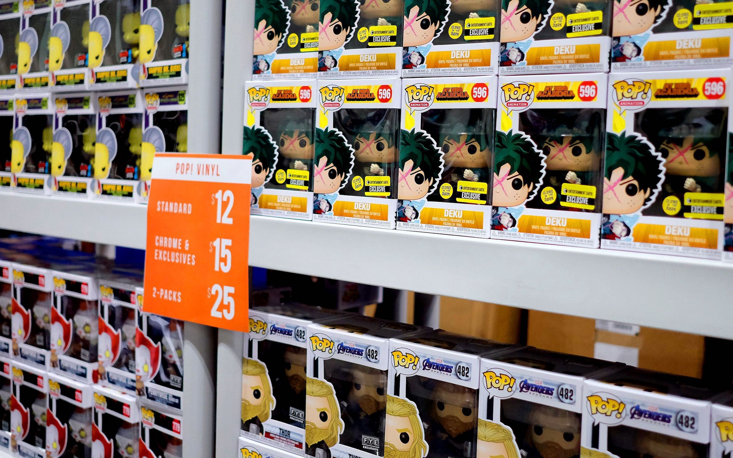 Boxes of Funko Pop figurines on shelves.
