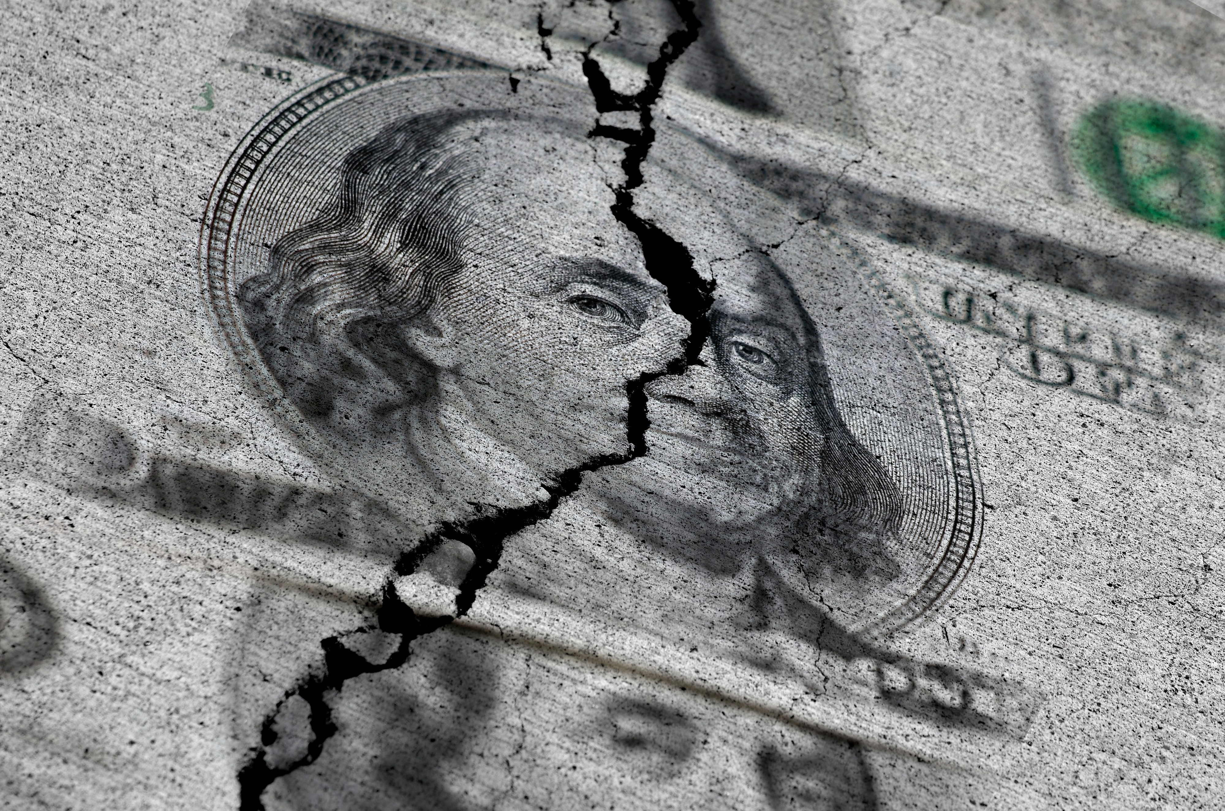 The photo shows a zoomed image on a Benjamin Franklin's face on a $100 bill. There is a crack running through his face extending from the top to the bottom of the frame.
