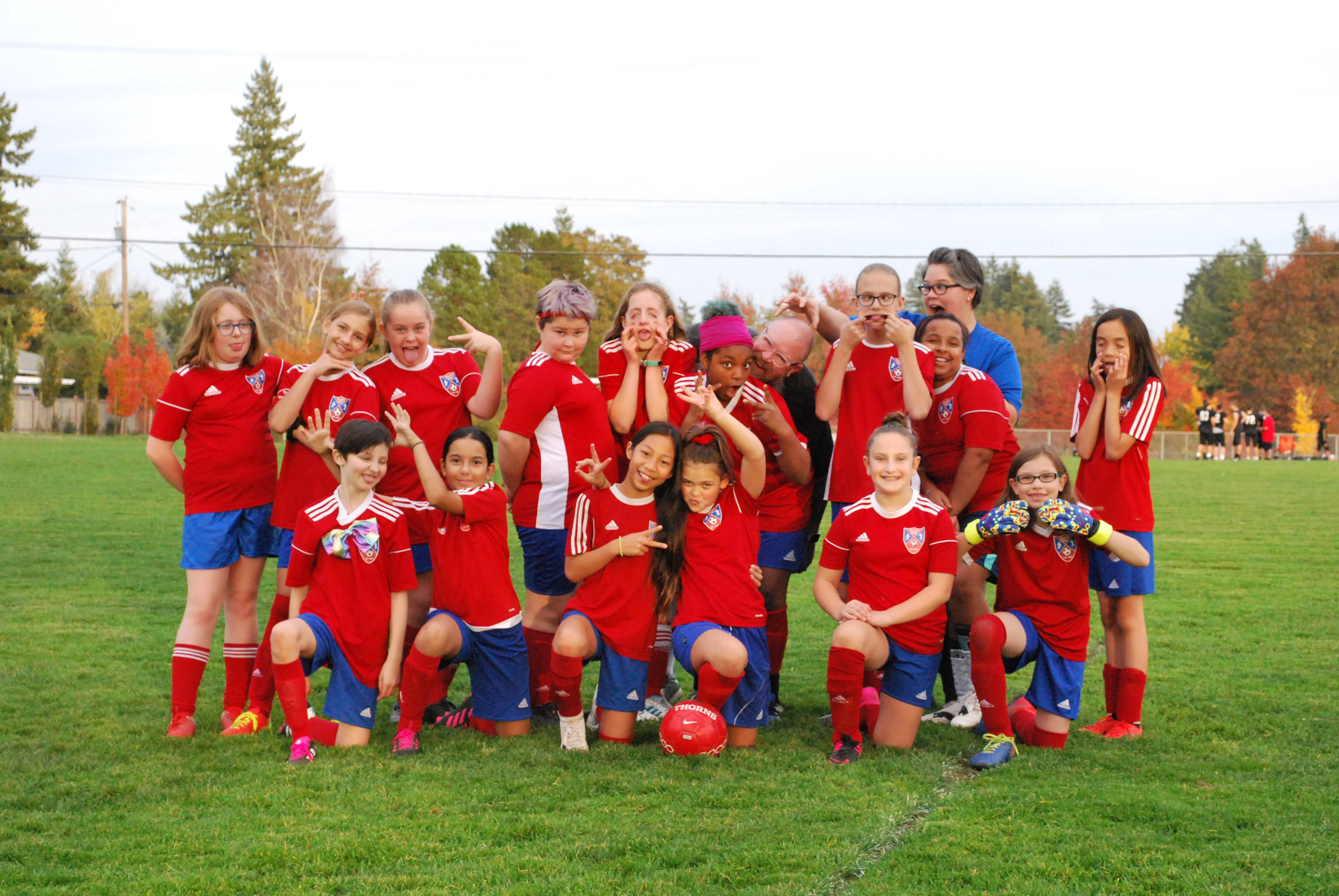 U-11 girls soccer team photo with goofy faces