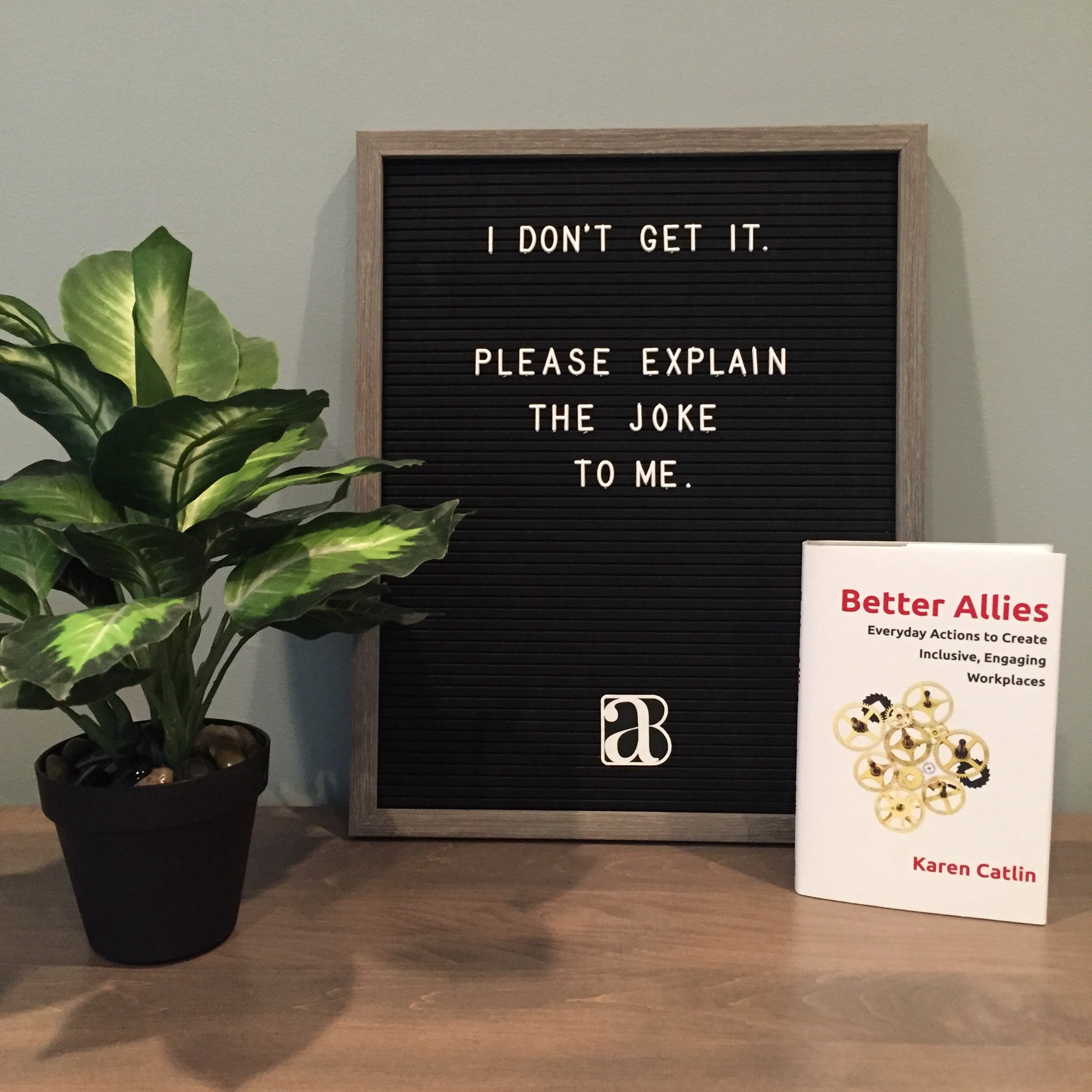 message board with I don't get it. Please explain the joke to me. With a copy of the Better Allies book by Karen Catlin